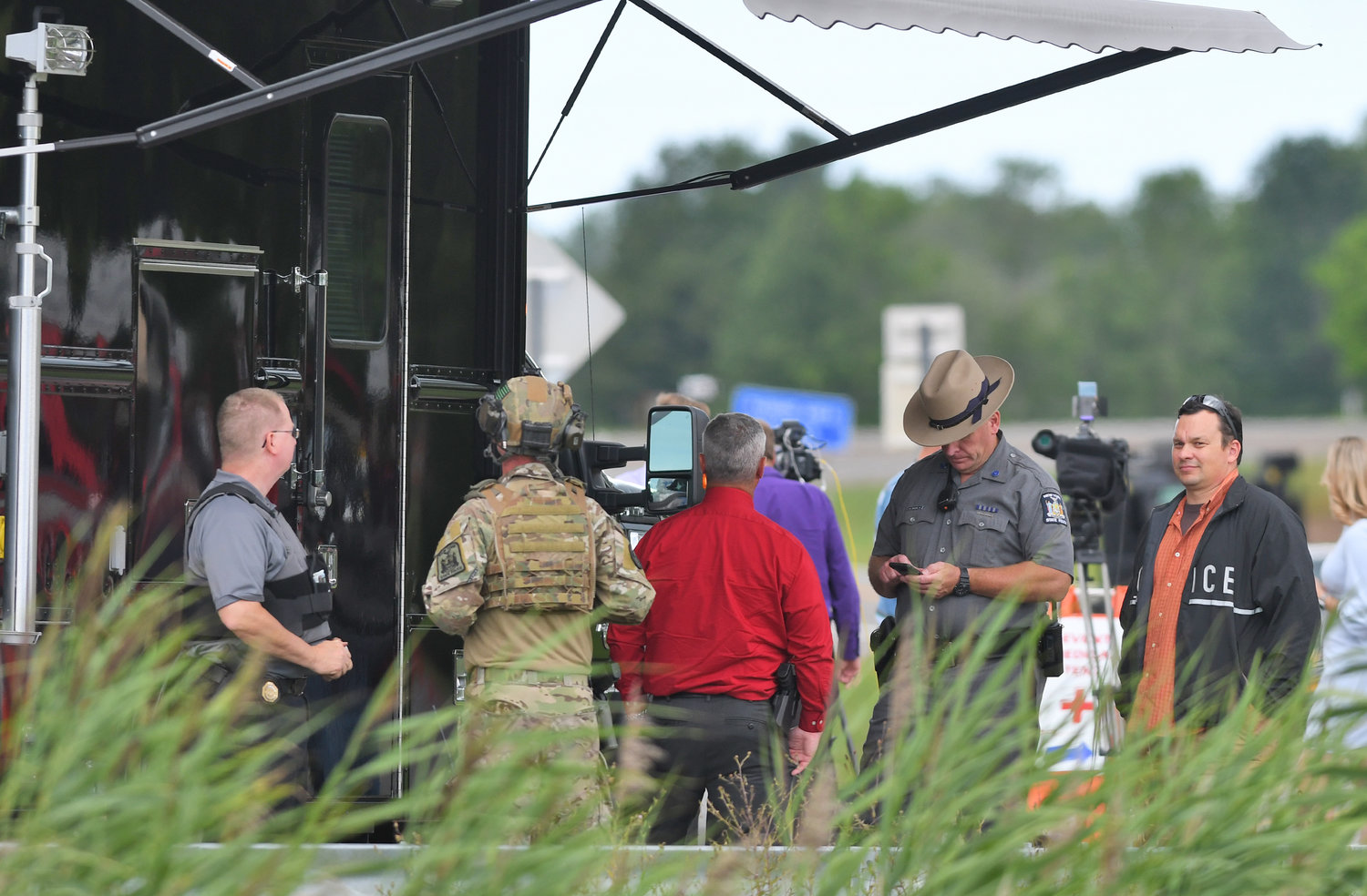 COMMAND CENTER — State police at the command center set up at the corner of routes 31 and 46 during Friday afternoon's standoff with an armed suspect.