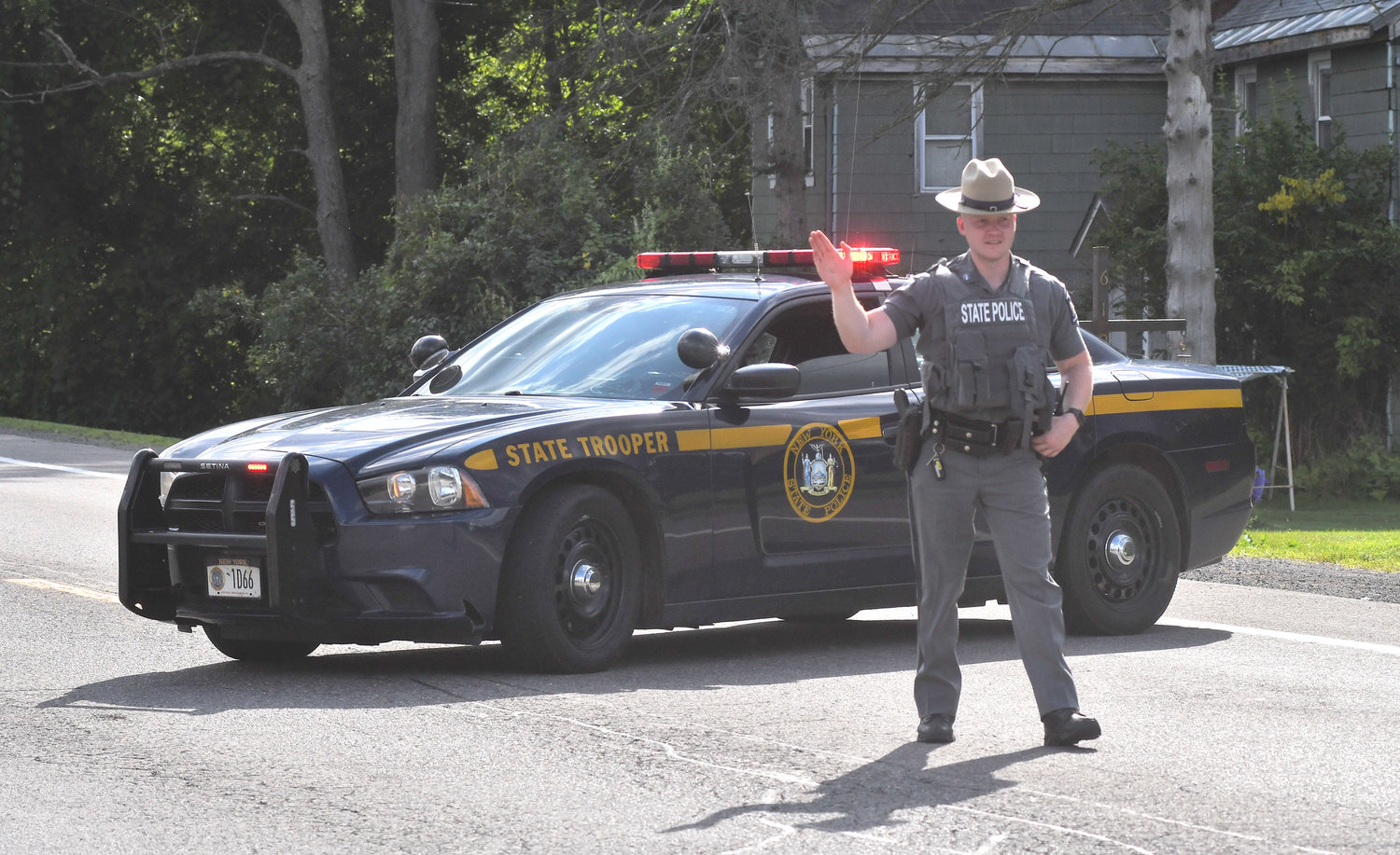 YOU SHALL NOT PASS — A state trooper redirects traffic at the intersection of Route 46 and Dunbarton Road during the nearby standoff in Verona Friday afternoon.