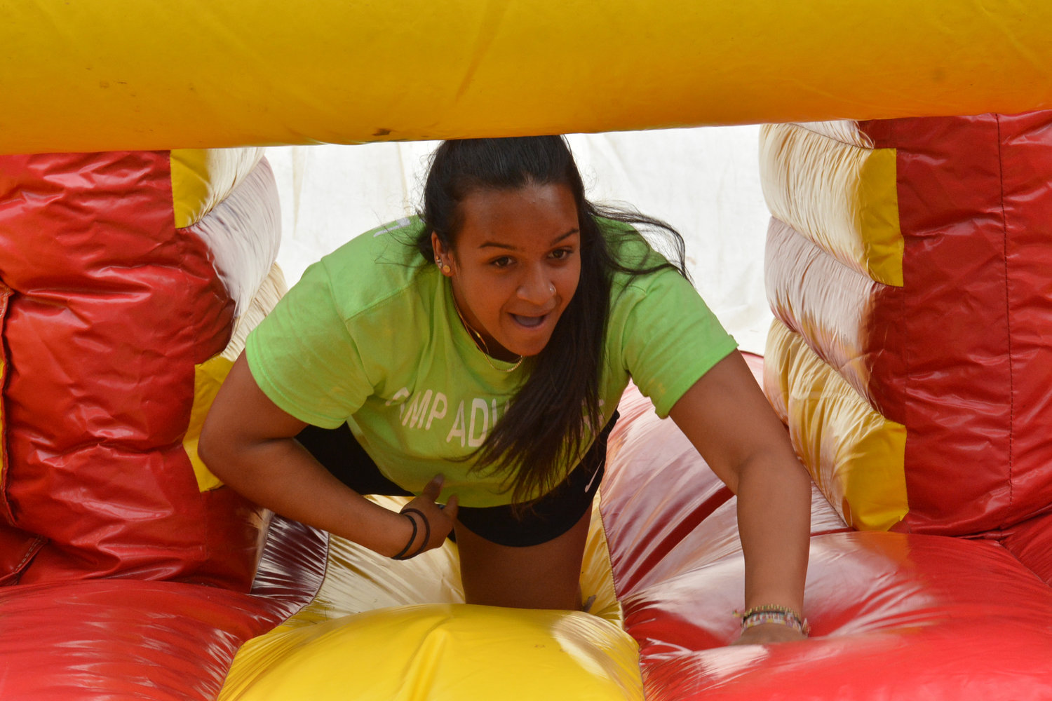 FUN INTERNSHIP — Julia DePietro, 19, is a Westmoreland High School graduating senior and a camp councilor at the Westmoreland Town Park Summer Youth Camp. Her she is playing with the kids who are on the other side of the blow-up tunnel. Seniors and juniors from Westmoreland, who are entering college in a related field typically sign on for these positions.