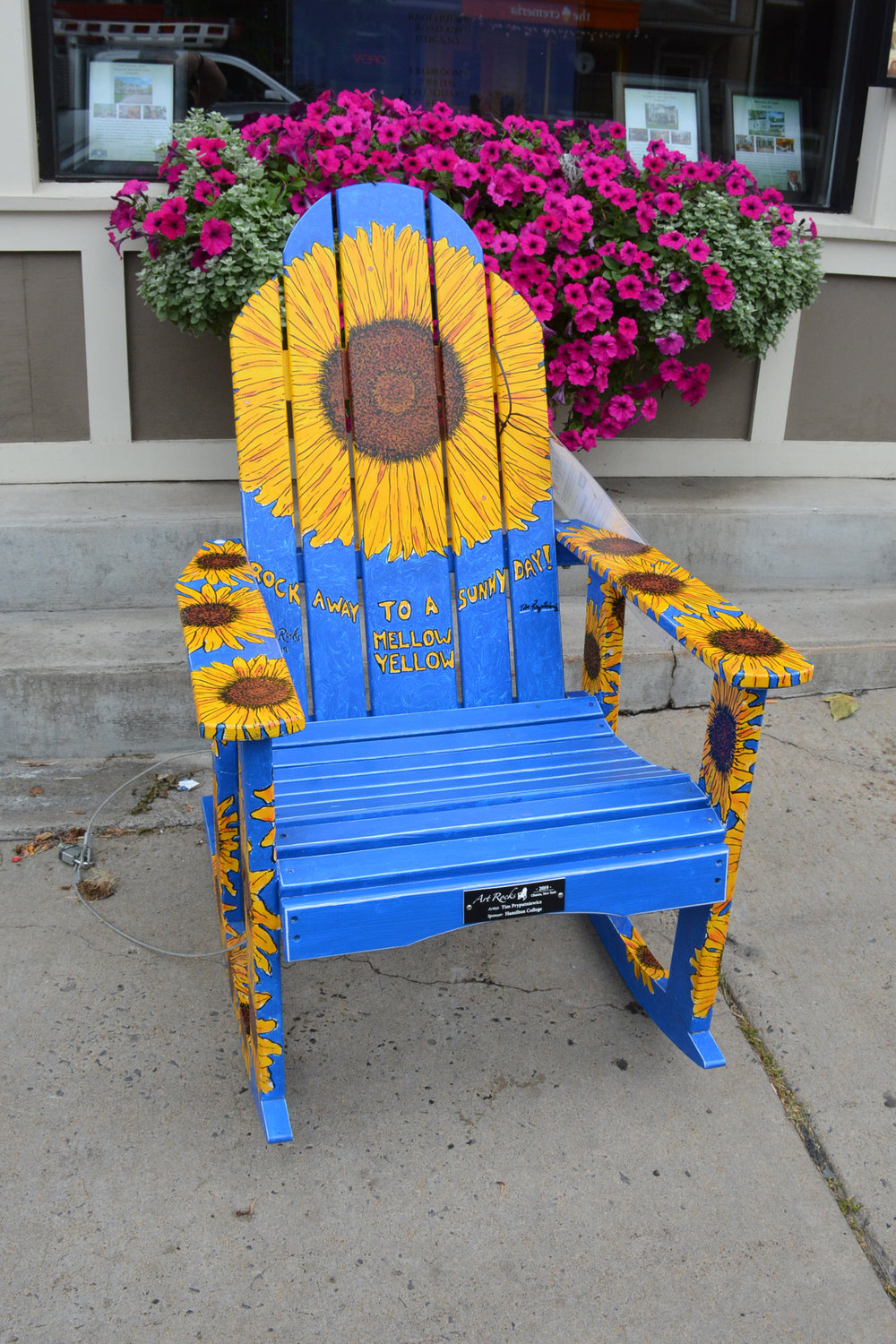 LET THE SUN SHINE — ART ROCKS! — This is one of the many chairs and benches painted by local artists that will be auctioned off at 4:30 p.m. Saturday, Aug. 24 during the annual Clinton Art & Music Festival. This chair was painted by Tim Pryputniewicz.
