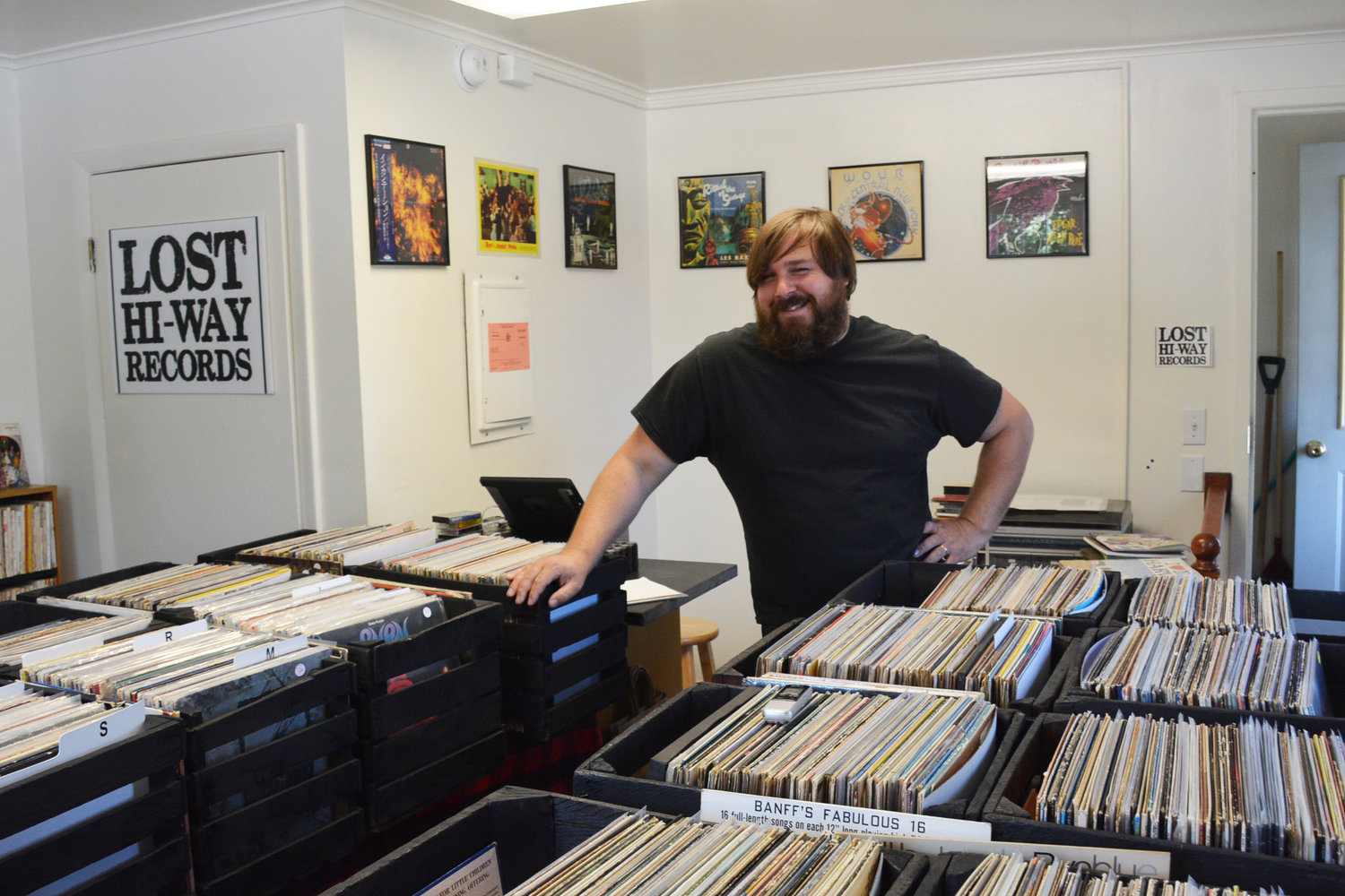 THE VINYL COUNTDOWN — Mike Zombek, along with his wife and business partner (not pictured) Alicia, of Deansboro, opened their vinyl record store in mid-July and stocks only about a fifth of what he owns in the store. Located at 32 College Street, behind the Subway sandwich shop, Zombek hopes to give Clintonians a store to browse and shop in other than just a regular gift shop.