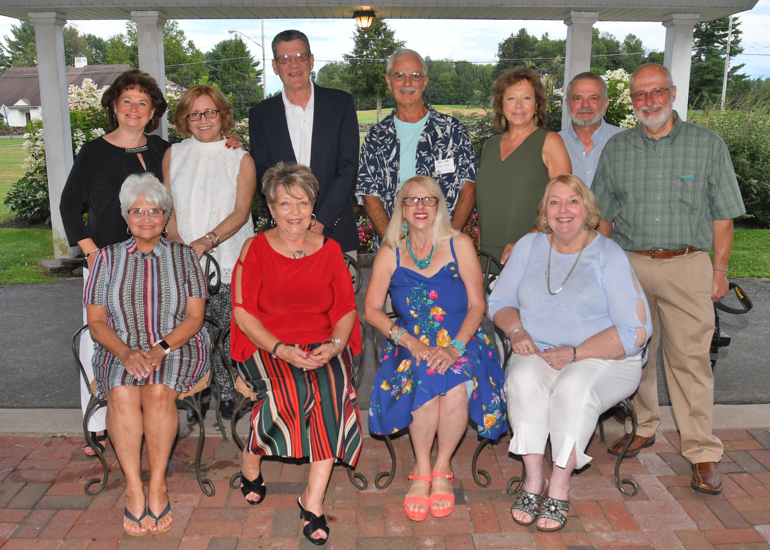TOGETHER AGAIN — Members of the Rome Free Academy Class of 1969 gathered together on Friday, Aug. 9, at the Teugega Country Club.  Among those rekindling old friendships were, from left, front row: Bonnie Bole Goetz; Carolyn Peluso Corigliano; Joan Conley Hills; Eleanor Stadler Marsh; Back row: Carol Daniello Furgol; Arlene Martin; Jerry Corigliano; John Ruscito; Janis Hubiak Norelli; Jack Trophia, Quantico, Va.; and Joe Fontana.