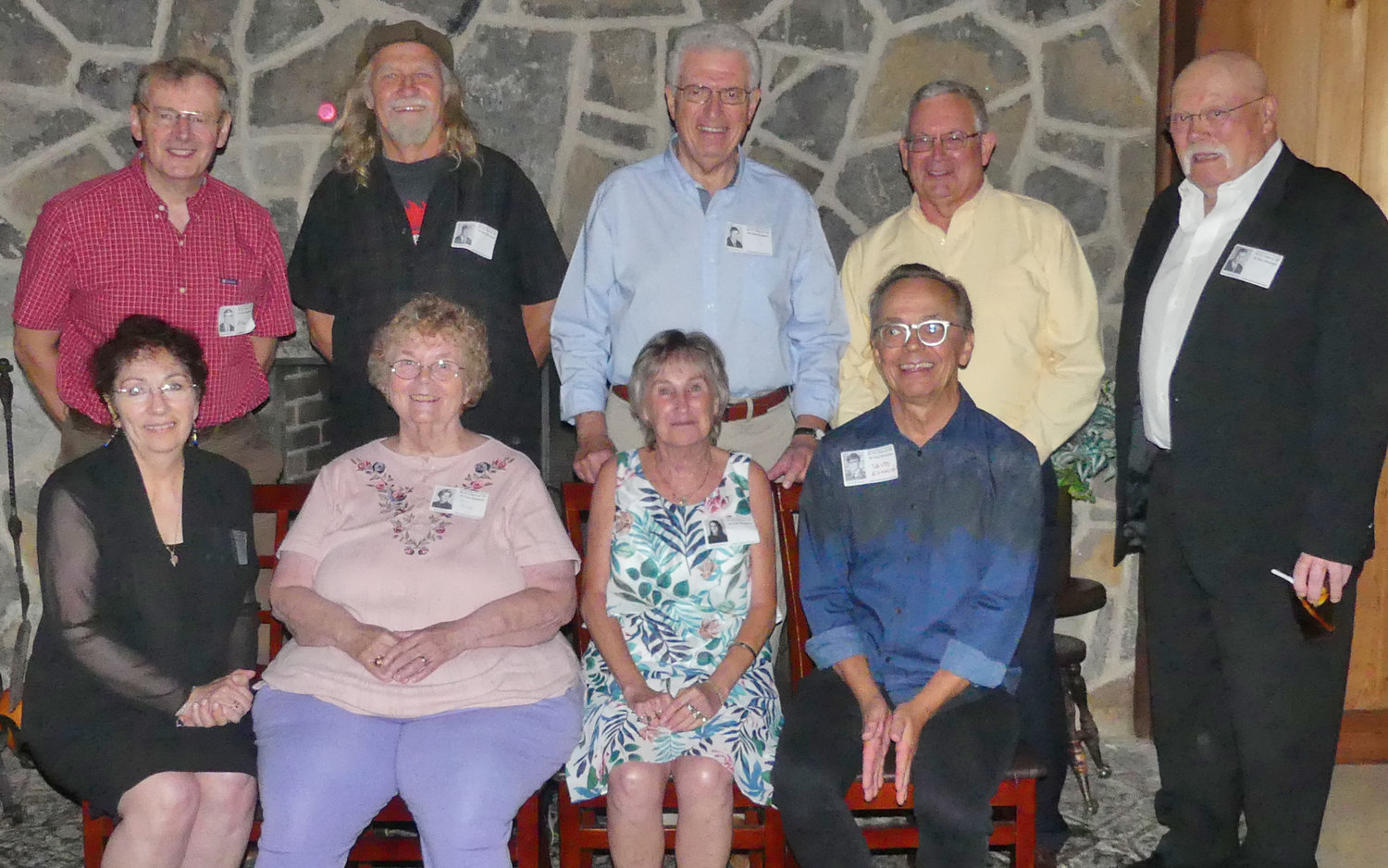 HOME TO CELEBRATE — Rekindling lasting friendships as well as making new ones were members of the Rome Catholic High School Class of 1969, which gathered for its 50-year-reunion on Saturday, Aug. 10, at the Teugega Country Club.  Those celebrating the milestone event included, from left, front row: Debra Booton McCoy, Eagle Bay; Diane Schoff, Latham; Mary Krenitsky Perrone, Sylvan Beach; and David Evanciew, Cazenovia; back row: Rev. Peter Schneible, St. Bonaventure; Joseph Baltrushes, Malibu, Calif.; Rev. Paul Angelicchio; Mark Werstein, Garnet Valley, Pa.; and Joseph Christopher, Canastota.