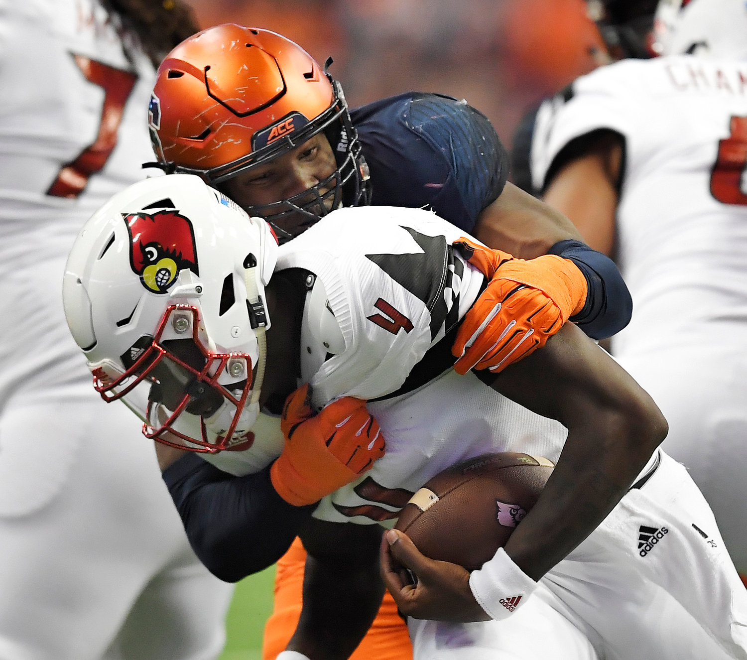 DEFENSIVE LEADER — Syracuse defensive lineman Alton Robinson, top, sacks Louisville quarterback Jawon Pass during the second half of last year's game at the Carrier Dome. Robinson is among the key returning players for the Orange.
