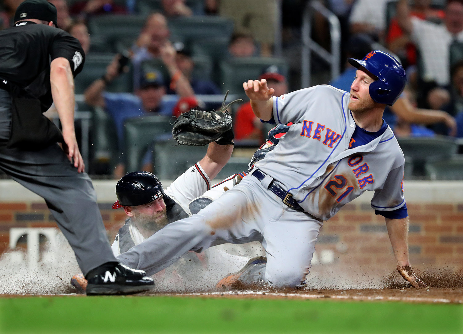 OUT AT THE PLATE — Braves catcher Brian McCann tags out the Mets' Todd Frazier at the plate on a throw from Ronald Acuna Jr. during the sixth inning of Tuesday's game in Atlanta.