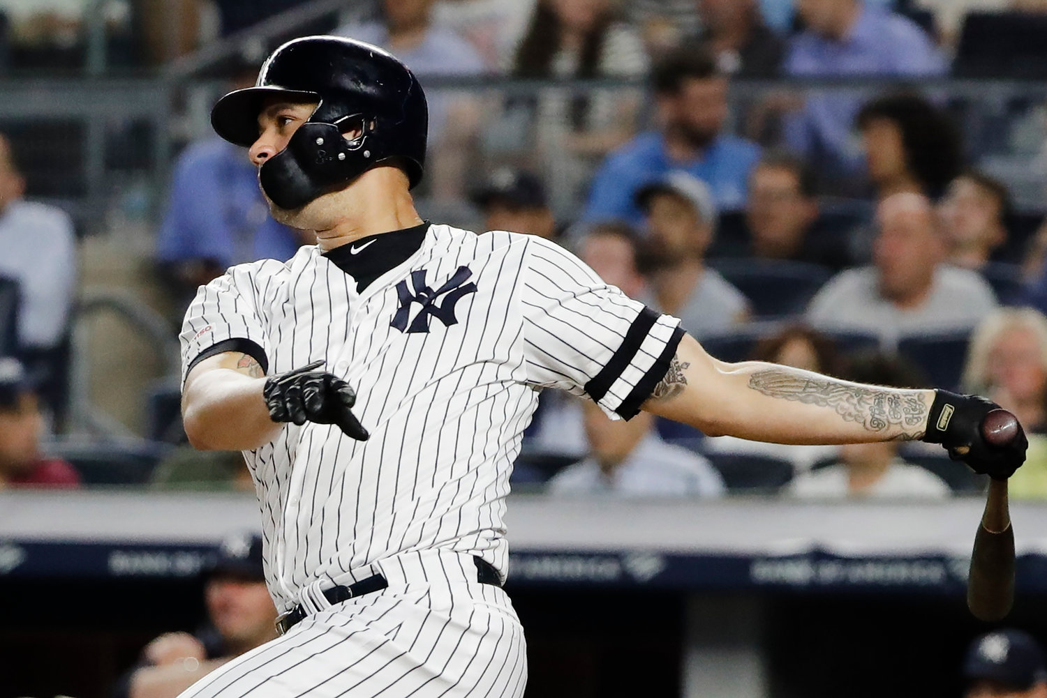 CONNECTS — Yankees batter Gary Sanchez follows through on an RBI double during the fourth inning of Tuesday's game against the Orioles in New York. The Yankees defeated Baltimore for the 15th time in a row, 8-3.