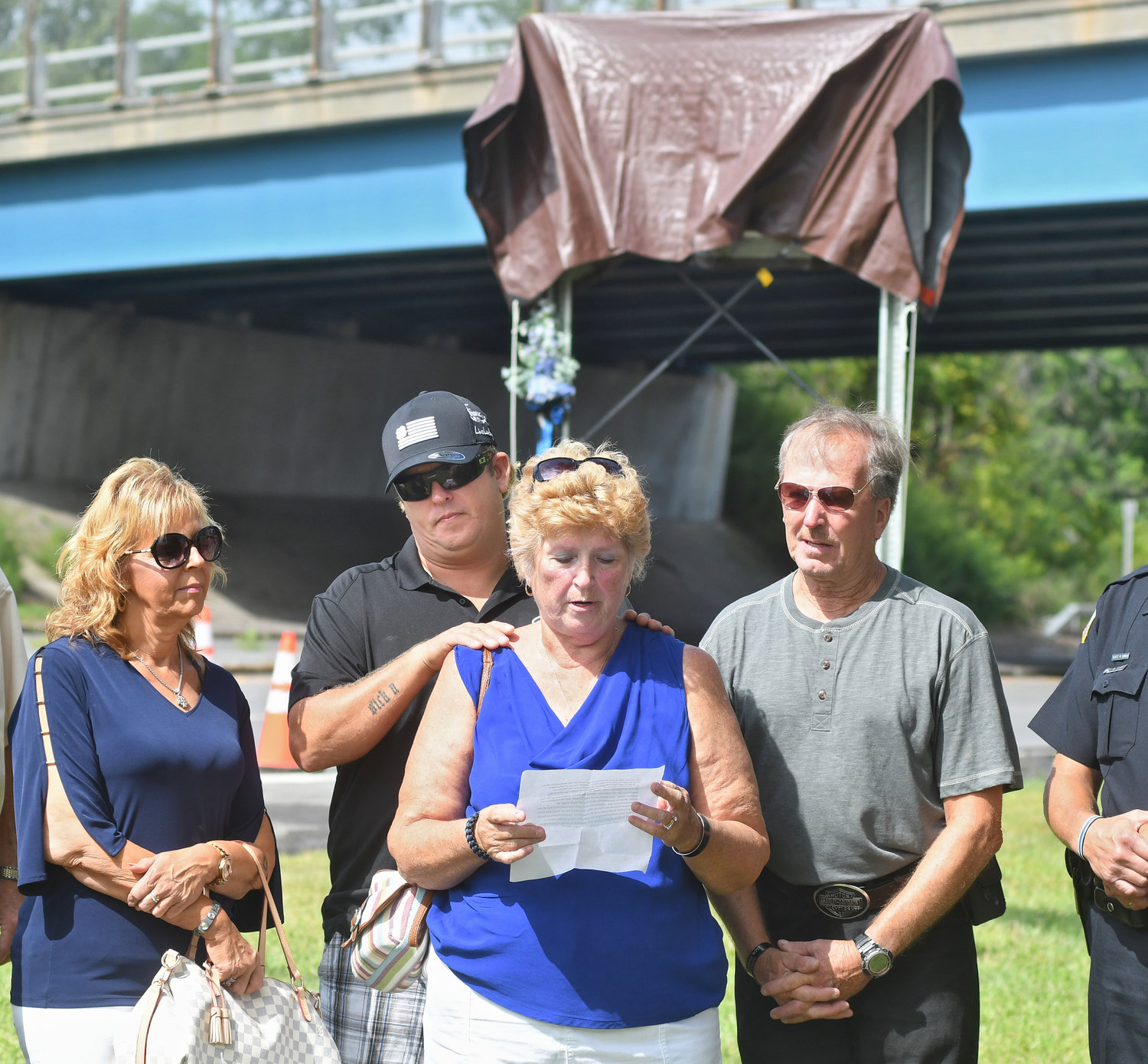 The Crossley family Natalie Beratta- girlfriend of Mike Crossley- older brother, Linda Crossley- mother and George Crossley listen to the prepared statement by mom LInda.
