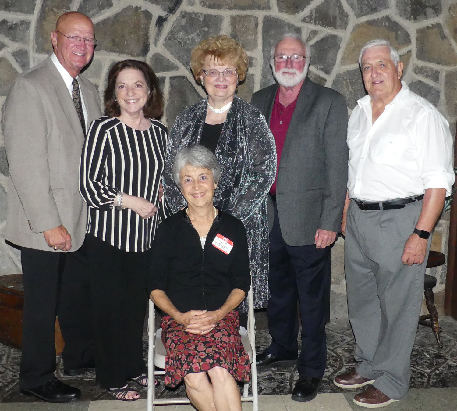 LASTING MEMORIES — Members of the Rome Free Academy Class of 1964 gathered for their 55-year reunion on Saturday at the Teugega Country Club.  Among those helping to bring classmates back together to celebrate old times as well as make new memories were members of the reunion committee, including, from left: Ron D'Amore, Fran D'Amore, Eileen DeRuby Urtz, Ron Barry, Ron Townsend. Judy Siegel, seated, came the farthest — from Florence, Italy, to join her classmates for the celebration.  The weekend reunion included an informal gathering on Friday at the Delta Lake Inn and Saturday's dinner party at Teugega.