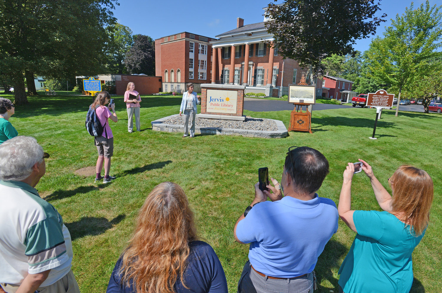 CITY SIGNIFICANCE — Mayor Jacqueline M. Izzo talks about the new historical markers at the Jervis Public Library and their importance to the city during a ceremony on the library grounds Tuesday.