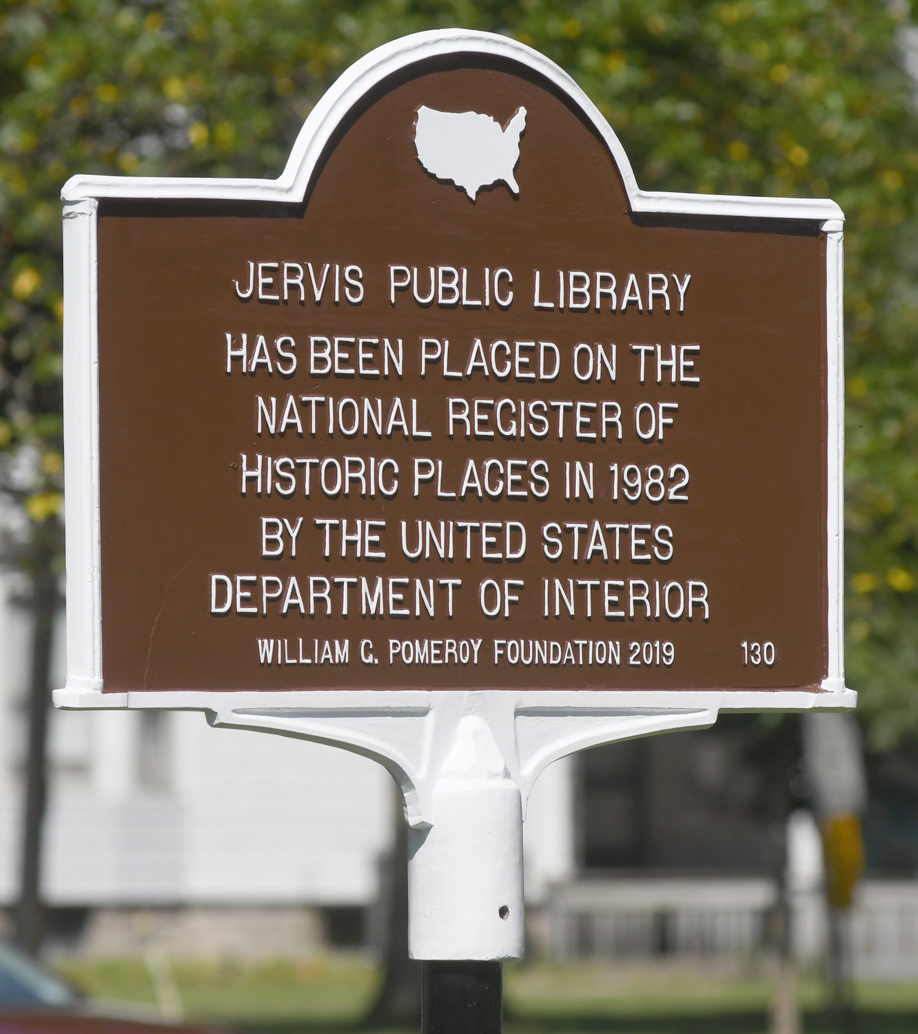SIGN OF THE PAST — The new National Historic Regster marker in front of Jervis Library Tuesday morning.