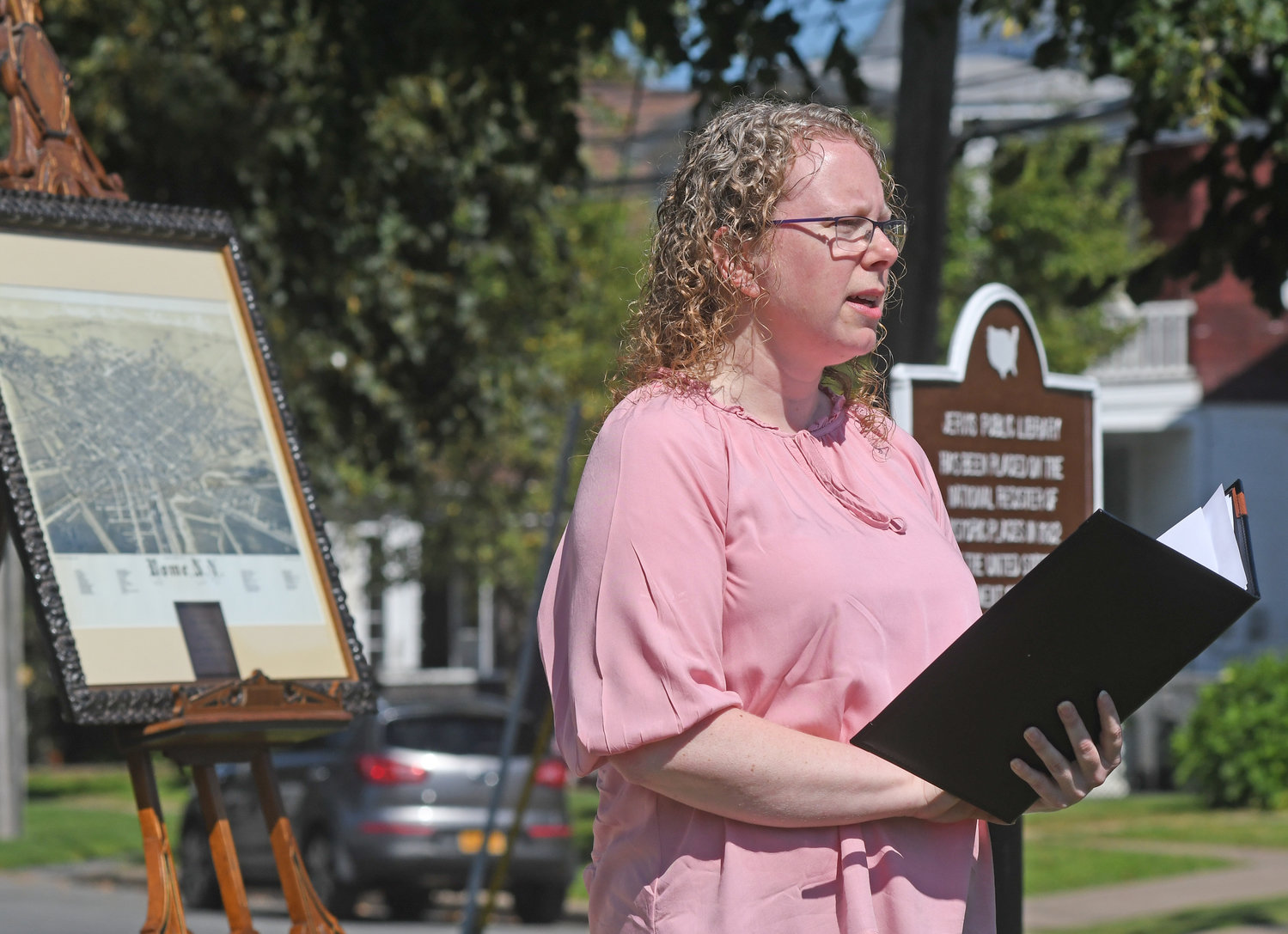 TIME TO SHINE — Lisa Matte, executive director of Jervis Public Library, discusses famed Rome engineer John B. Jervis during a ceremony on Tuesday in the bright sunshine on the library's front lawn.