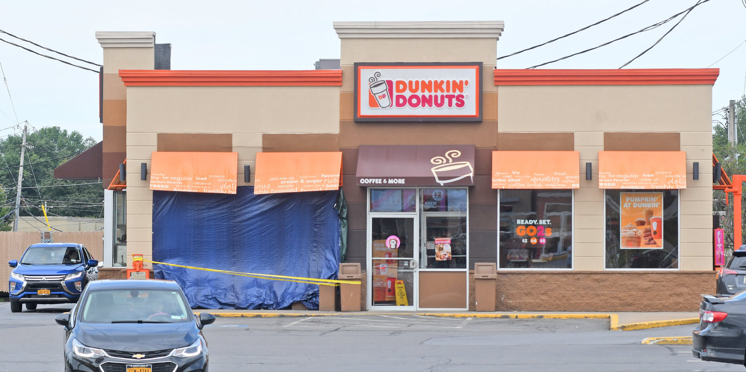 BACK IN BUSINESS — With a fresh tarp and caution tape out front, the Dunkin' Donuts on Black River Boulevard was open for business today. Police said an SUV crashed into the front wall and window Wednesday morning. No one was injured.