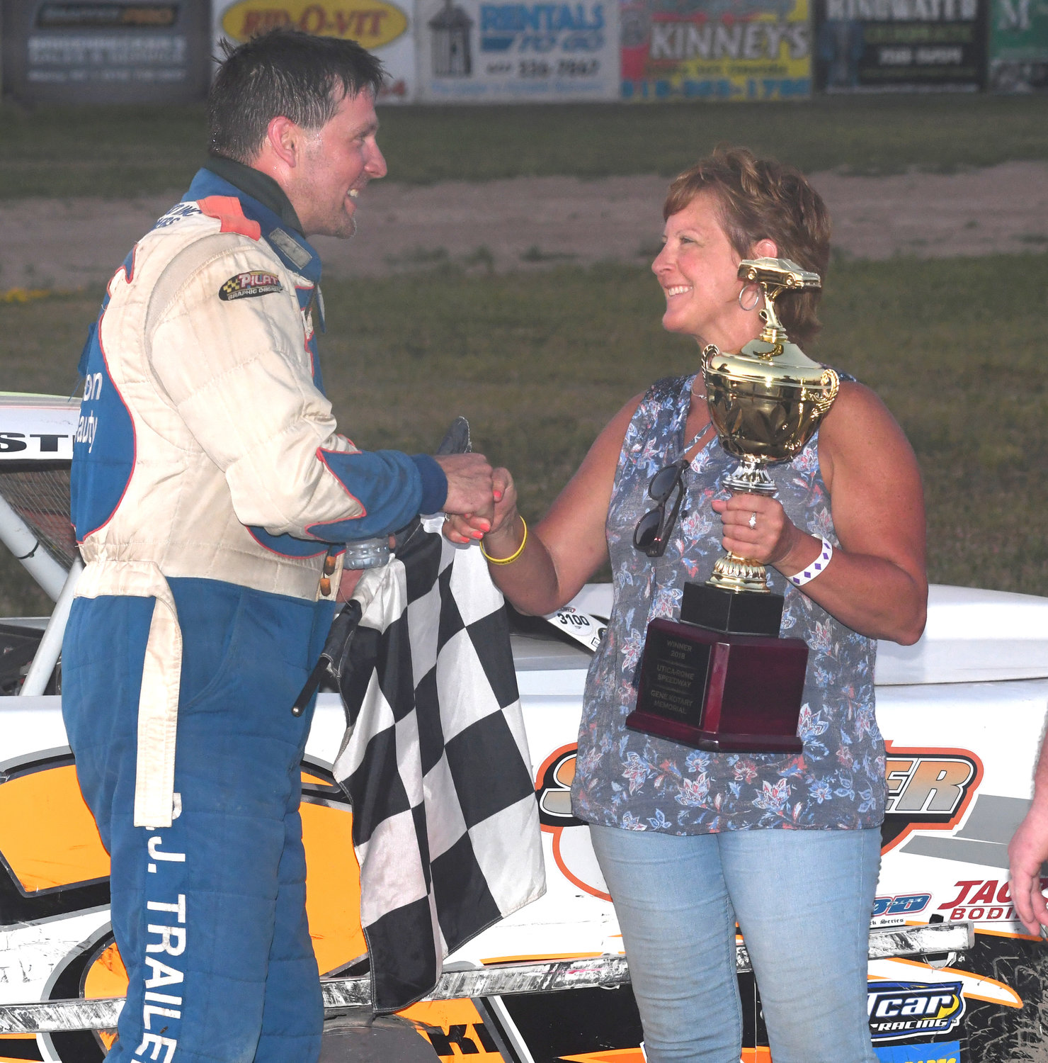 GENE KOTARY WINNER — Pete Stefanski of Westmoreland, winner of the Gene Kotary Memorial Pro Stock challenge, gets congratulated by Marcia Kotary, wife of the late Gene Kotary in victory lane at Utica-Rome Speedway.