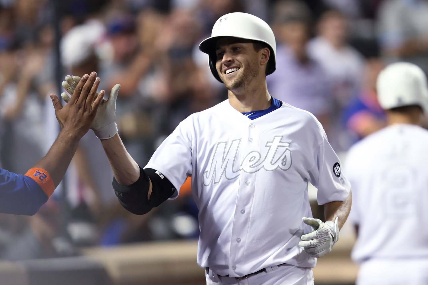HELPING HIS OWN CAUSE — Mets pitcher Jacob deGrom celebrates after hitting a home run during the sixth inning of Friday's game against the Braves in New York. DeGrom struck out 13 in seven innings, but the Braves won 2-1 in 14 innings.