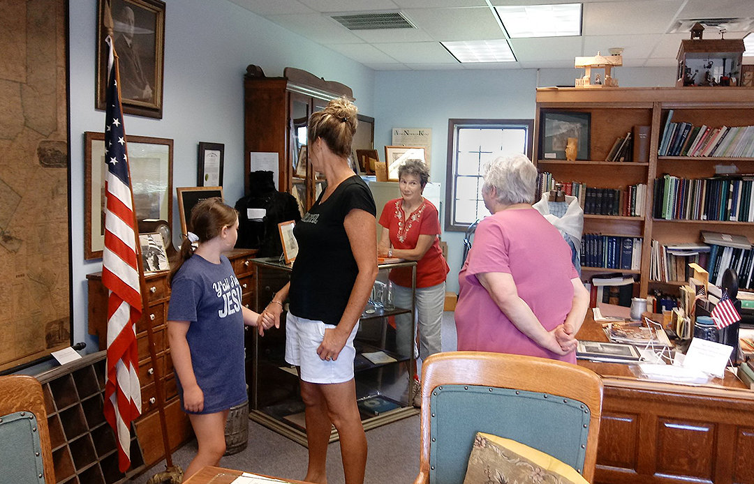 TOUR CONDUCTED — Sandy Rolewicz conducts a tour of the Westmoreland Historical Society's Display Room for members of the Lairdsville Methodist Church.