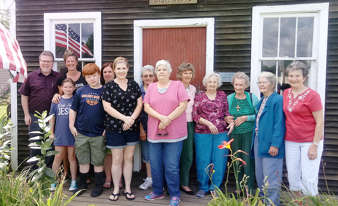 FIELD TRIP — Parishoners from the Lairdsville Methodist Church visit the Westmoreland Historical Society's one-room schoolhouse.