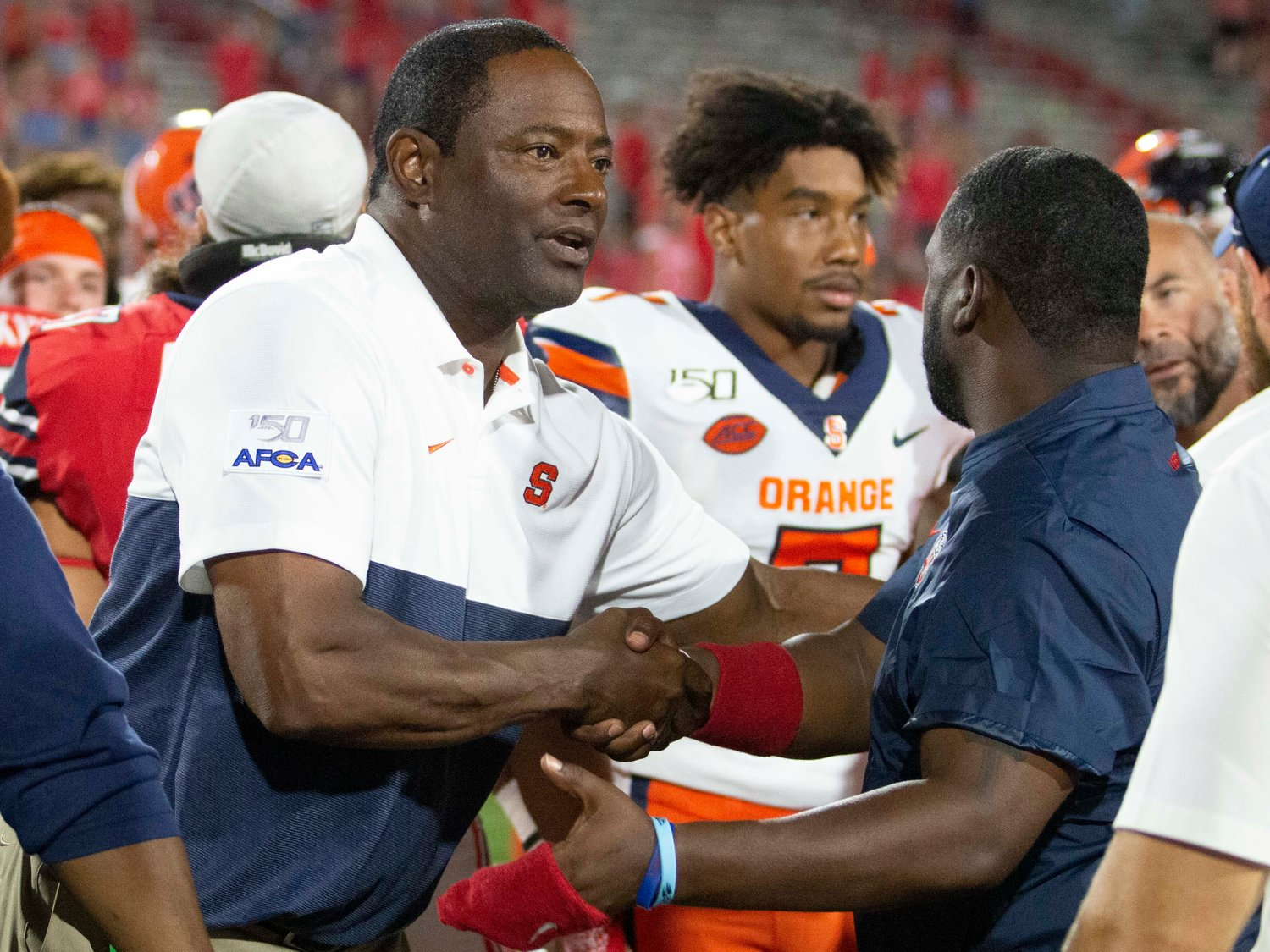 Syracuse head coach Dino Babers shakes hands after shutting out Liberty 24-0 during an NCAA game in Lynchburg, Va. Saturday.
