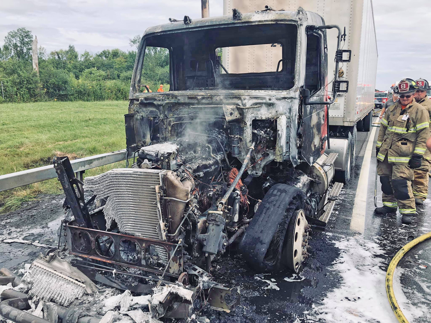 TRUCK DESTROYED — The smoldering wreckage of a tractor trailer fire on the Thruway in Westmoreland Tuesday, Aug. 27. Fire officials said no one was injured.
