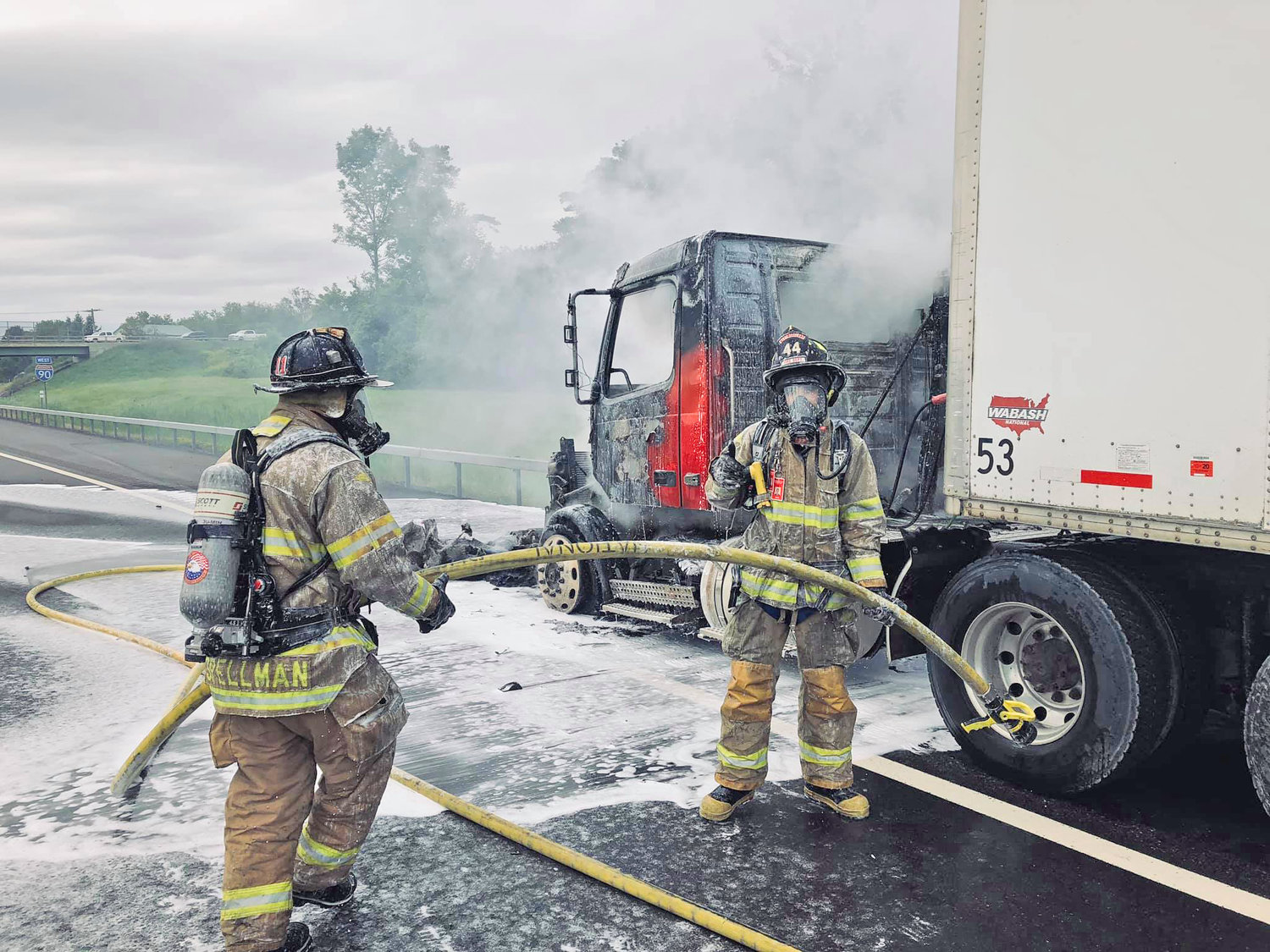 THRUWAY FIREFIGHT — Westmoreland firefighters use foam to knock down a tractor trailer cab fire on the Thruway near Route 233 Tuesday, Aug. 27. Fire officials said the driver escaped without injury.