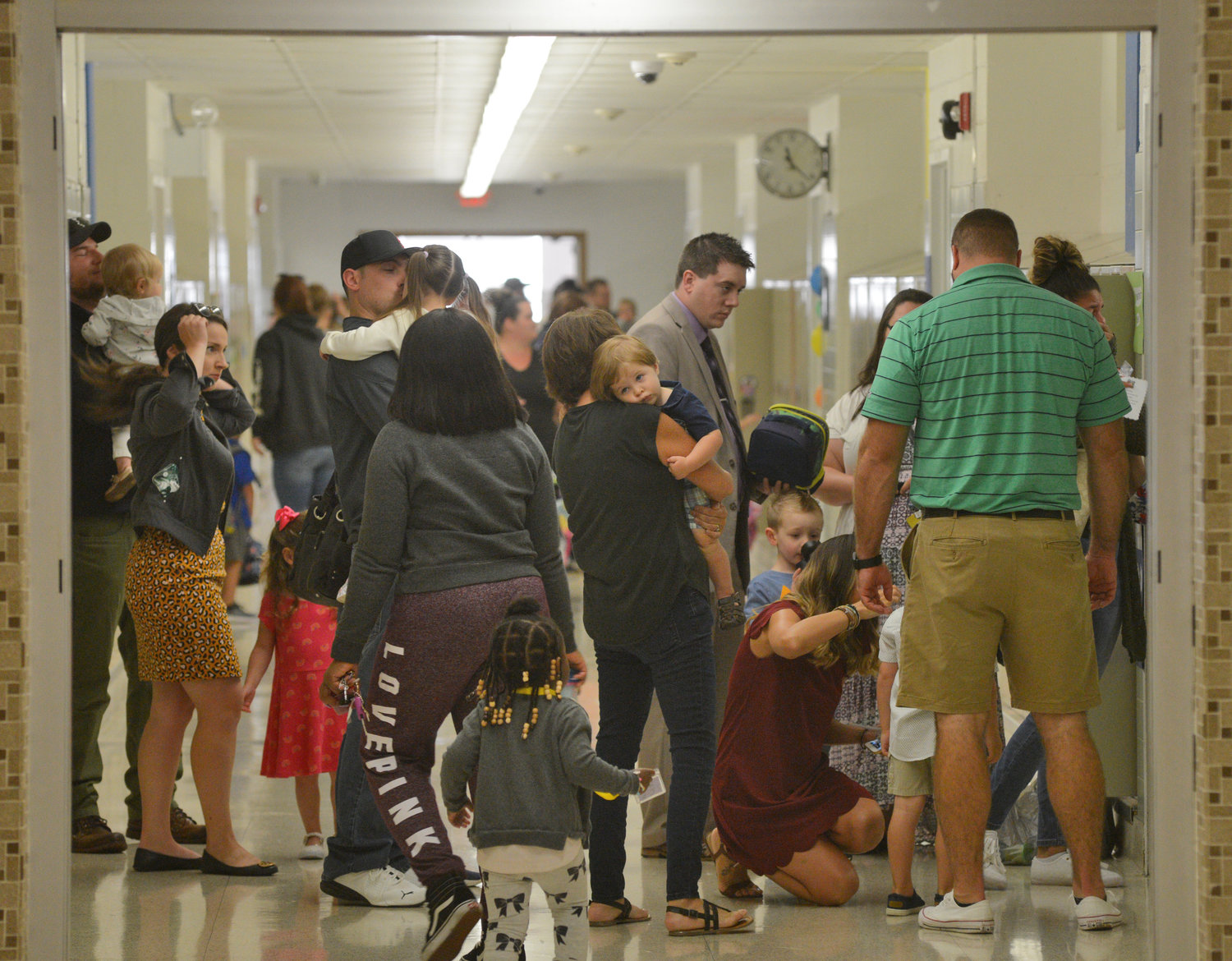 The halls at Rome Catholic are once again filled with students and- today- parents on the first of school at the newly re-opened Catholic school on Cypress St.