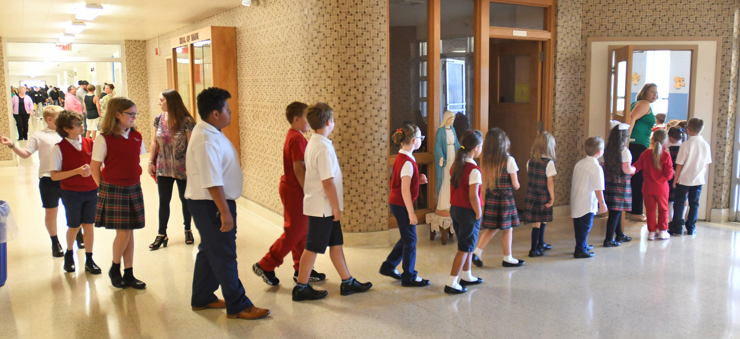 students file in to the Chapel at Rome Catholic on the first day of school.