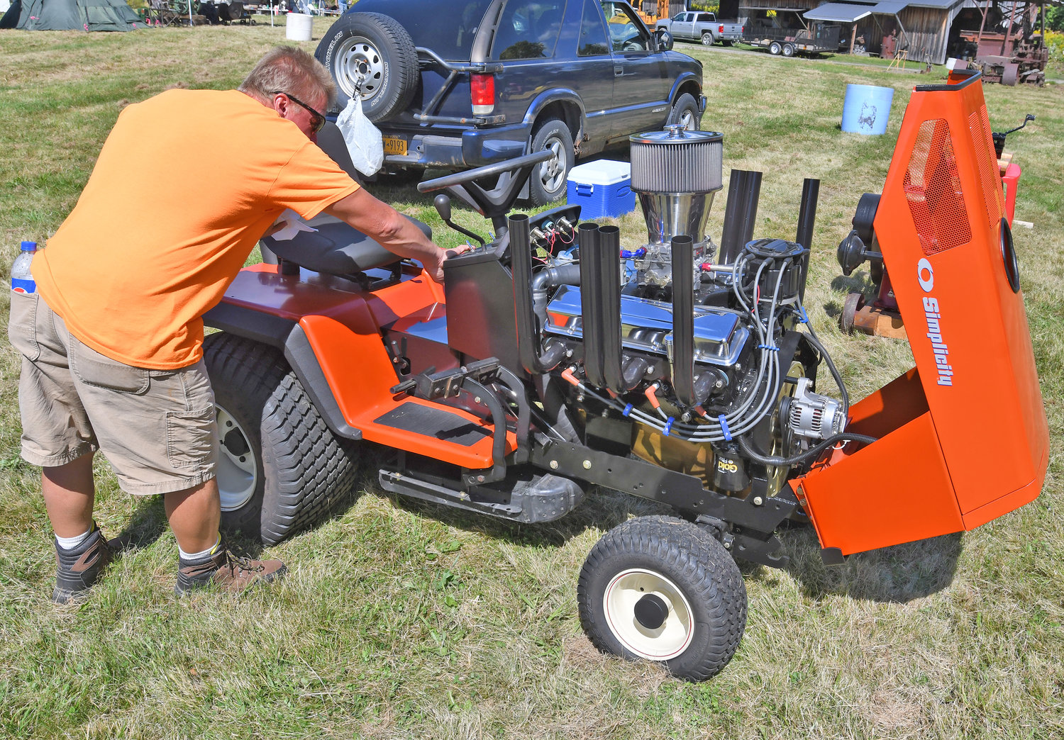 STARTING HIS ENGINE — Carl Fleming of Gouverneur  starts his Simplicity Sunstar lawnmower equipped with a 267 Chevy small block motor on Friday afternoon during the first day of the 44th annual Old Time Gas Engines, Tractors and Truck Show at the Flywheels and Pulleys Club in Constableville. The event continues today into the evening, and Sunday from 8 a.m.-6 p.m.