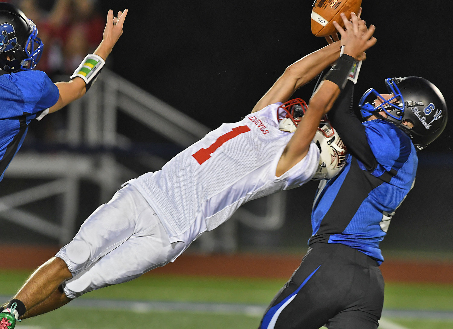 GOOD TRY — VVS running back James Wheeler IV reaches for the ball but can't make the catch as he is defended by Camden's Eric Mitchell, right, during Friday night's Class B East game in Camden. The visiting Red Devils won, 34-14.