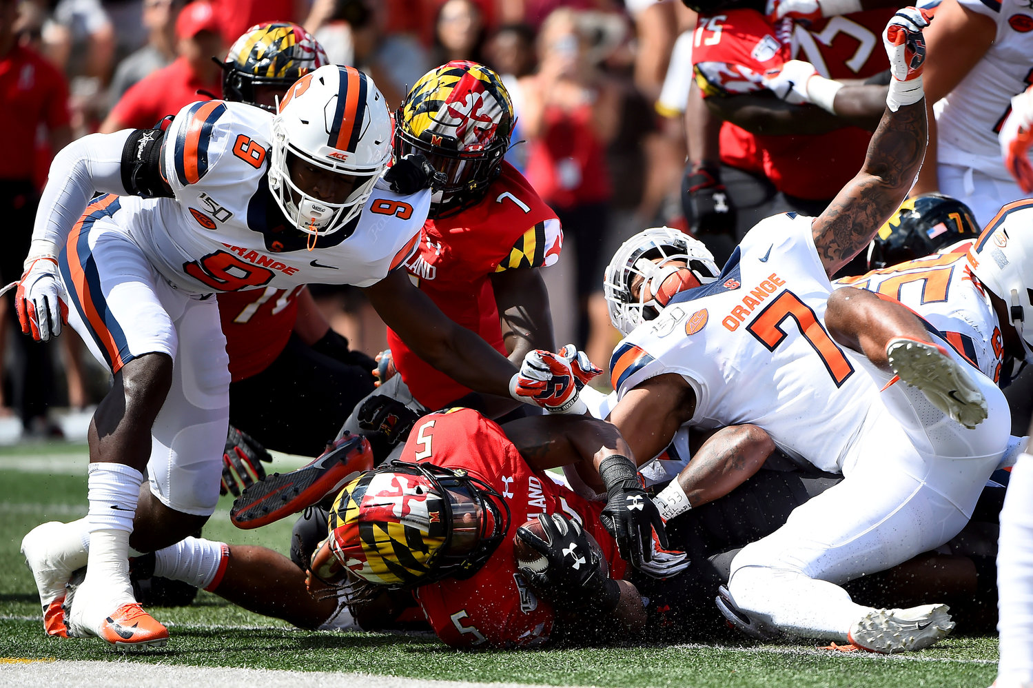 FINDING PAYDIRT — Terrapins running back Anthony McFarland Jr. (5) falls in to the end zone for a touchdown in front of Orange defenders during the first half of a college football game on Saturday in College Park, Md. The Orange fell 63-20.