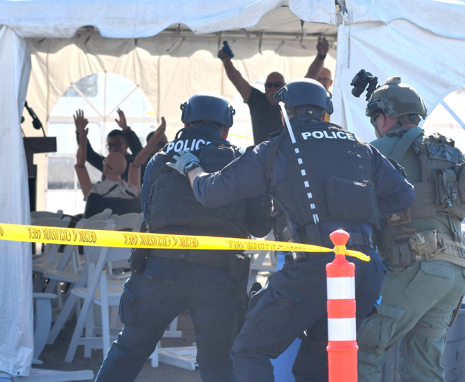 CHURCH IN SESSION — Several SWAT officers enter a church tent in Whitestown to confront a gunman who has been shooting attendees and broadcasting his attack live on the internet. This was one of several training scenarios during the Excelsior Challenge this week.