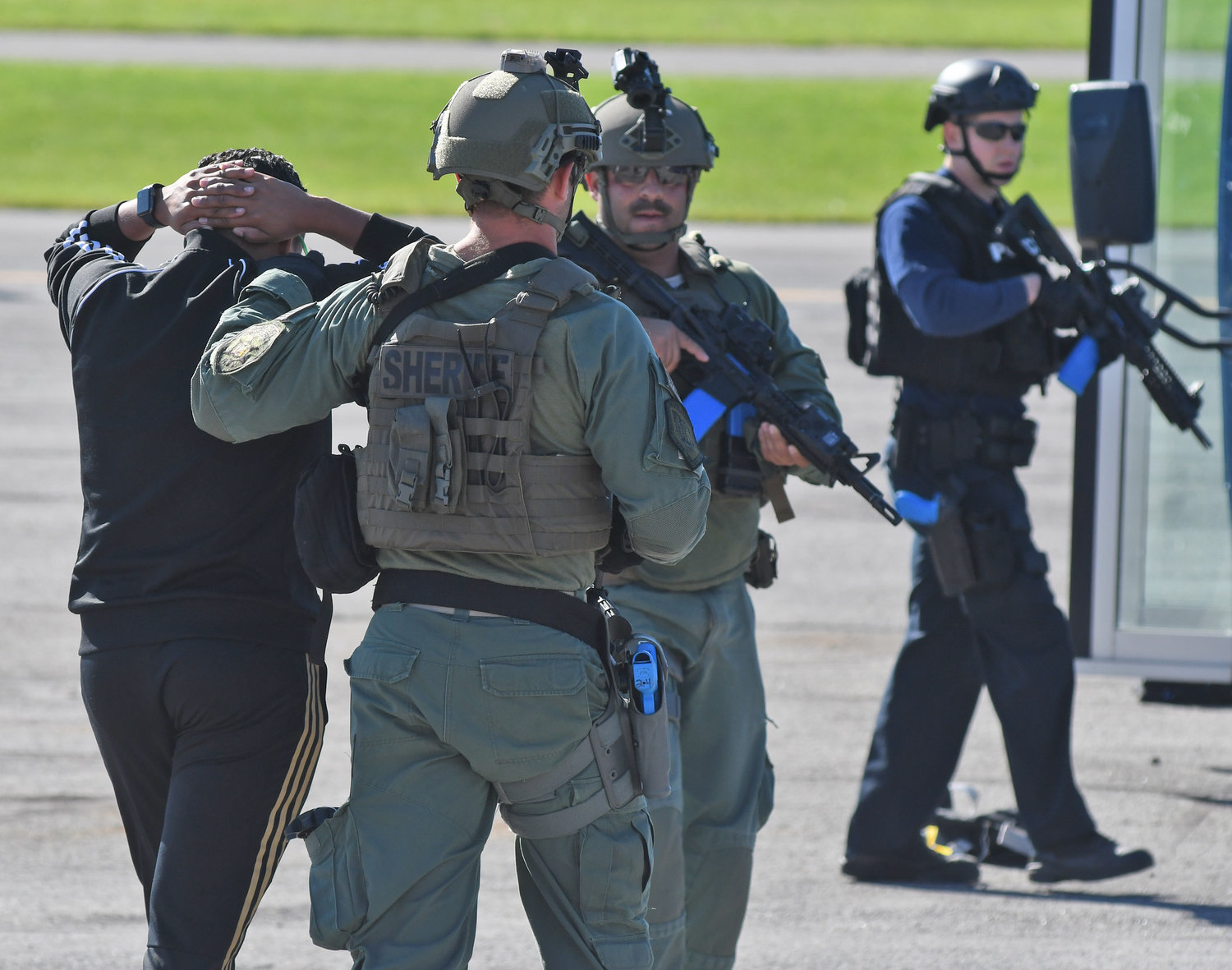 IN CUSTODY — A volunteer role-player holds his hands on his head while law enforcement escorts him from the scene of a training session at the Preparedness Training Center in Whitestown on Thursday.