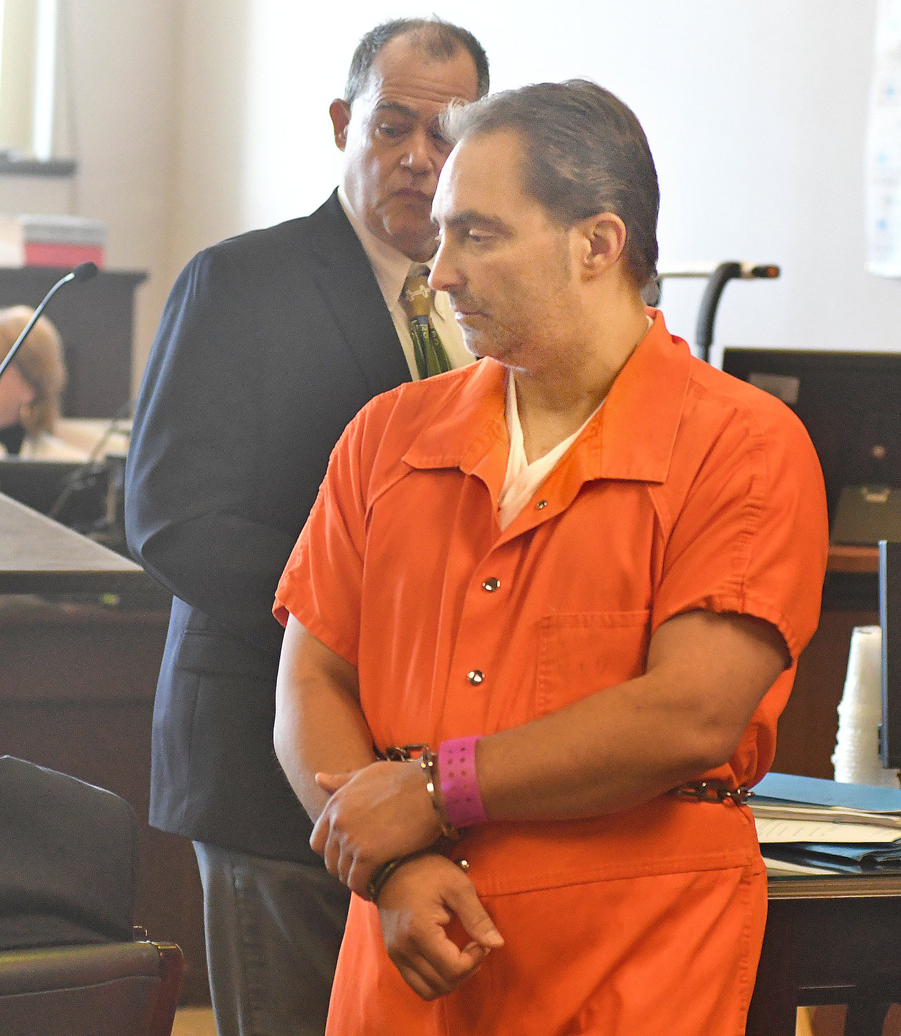 MAINTAINING HIS INNOCENCE — Jason P. D'Avolio enters County Court in Utica today. A not guilty plea was entered on his behalf in the death of his wife Kerrilee D'Avolio. He is charged with one count each of second-degree murder and concealment of a human corpse. In the background is Leland D. McCormac III, chief trial counsel for the county Public Defender's Office.