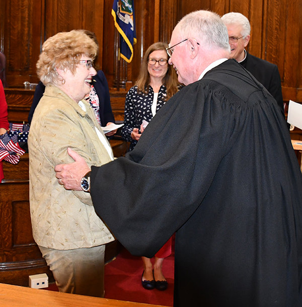 WELCOME TO THE UNITED STATES — Clinton resident Doris Hellinger shakes hands, and is congratulated by the Honorable David N. Hurd during a Naturalization Ceremony on Thursday, Sept 26 at the Oneida County Surrogate Court in Rome. Helliger said the hardest part of taking the citizenship test was trying to remember all the answers she studied for, for three months.