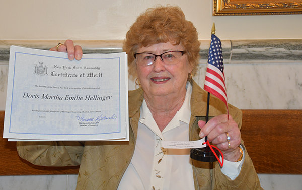 PROUD TO BE AN AMERICAN — Clinton resident Doris Hellinger fights back the tears as she holds up her naturalization certificate, after being sworn in as a new U.S. citizen on Thursday, Sept. 26 at the Oneida Surrogate Court in Rome. She said if someone had told her she would have done this now, at this time of her life, she never would have believed them.