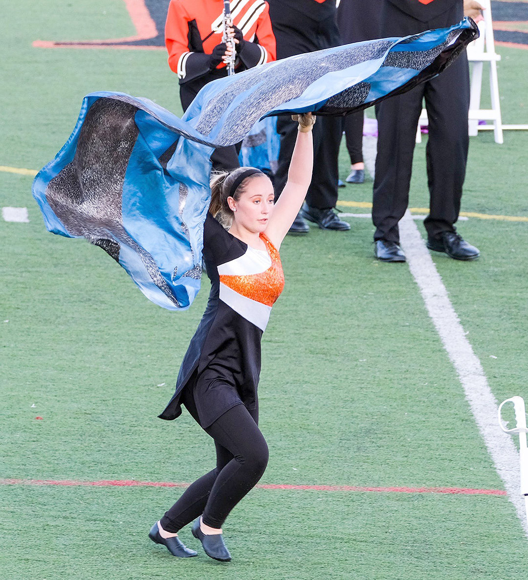 GIVING IT A WHIRL — Color guard member Becky Worth steps into a sequence for the Rome Free Academy marching band during a homecoming program at RFA Stadium on Sept. 27.