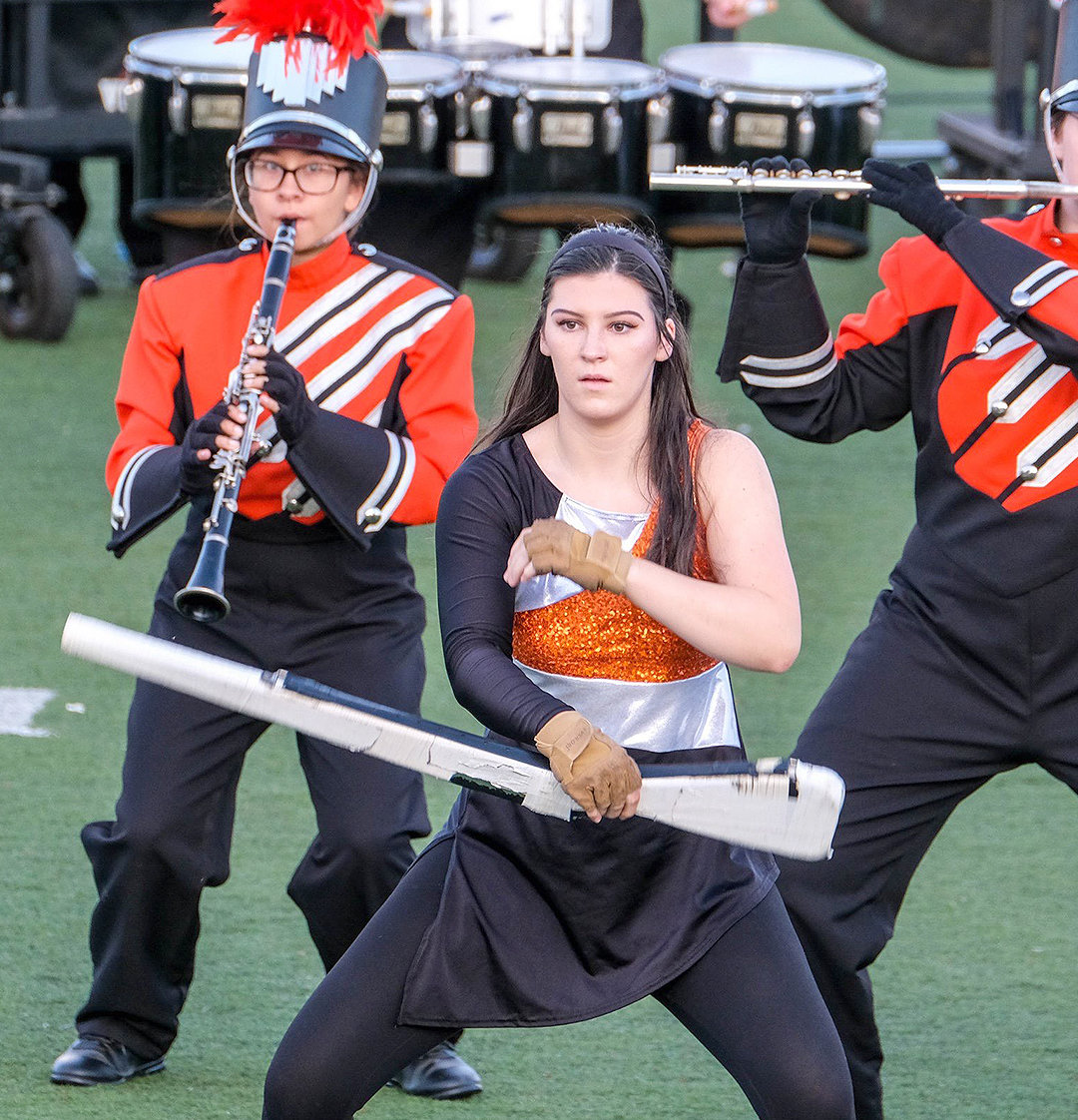 GETTING THE HANDLE — Rome Free Academy color guard member Lily Fleming performs as part of homecoming activities Sept. 27 at RFA Stadium.