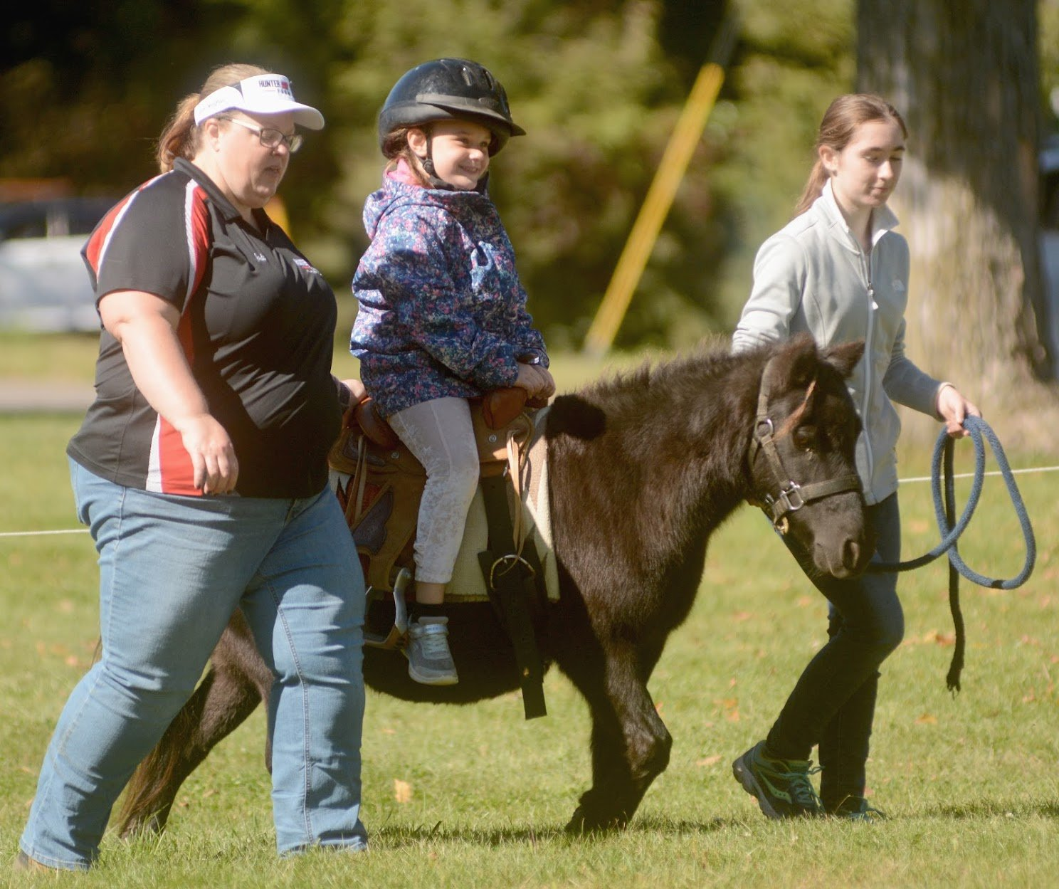 LOCKTOBERFEST FUN — Maci Jaynes 4, daughter of Brandyn Jaynes, enjoys a horse rides with handlers from Hunter Hack Farm at Locktoberfest which was held at Bellamy Harbor Park on Saturday.