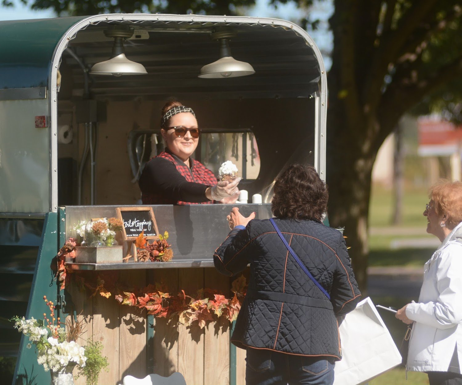 Alyssa Brement owner of Tails and Toppings hands out a yummy ice cream dish at Locktoberfest.