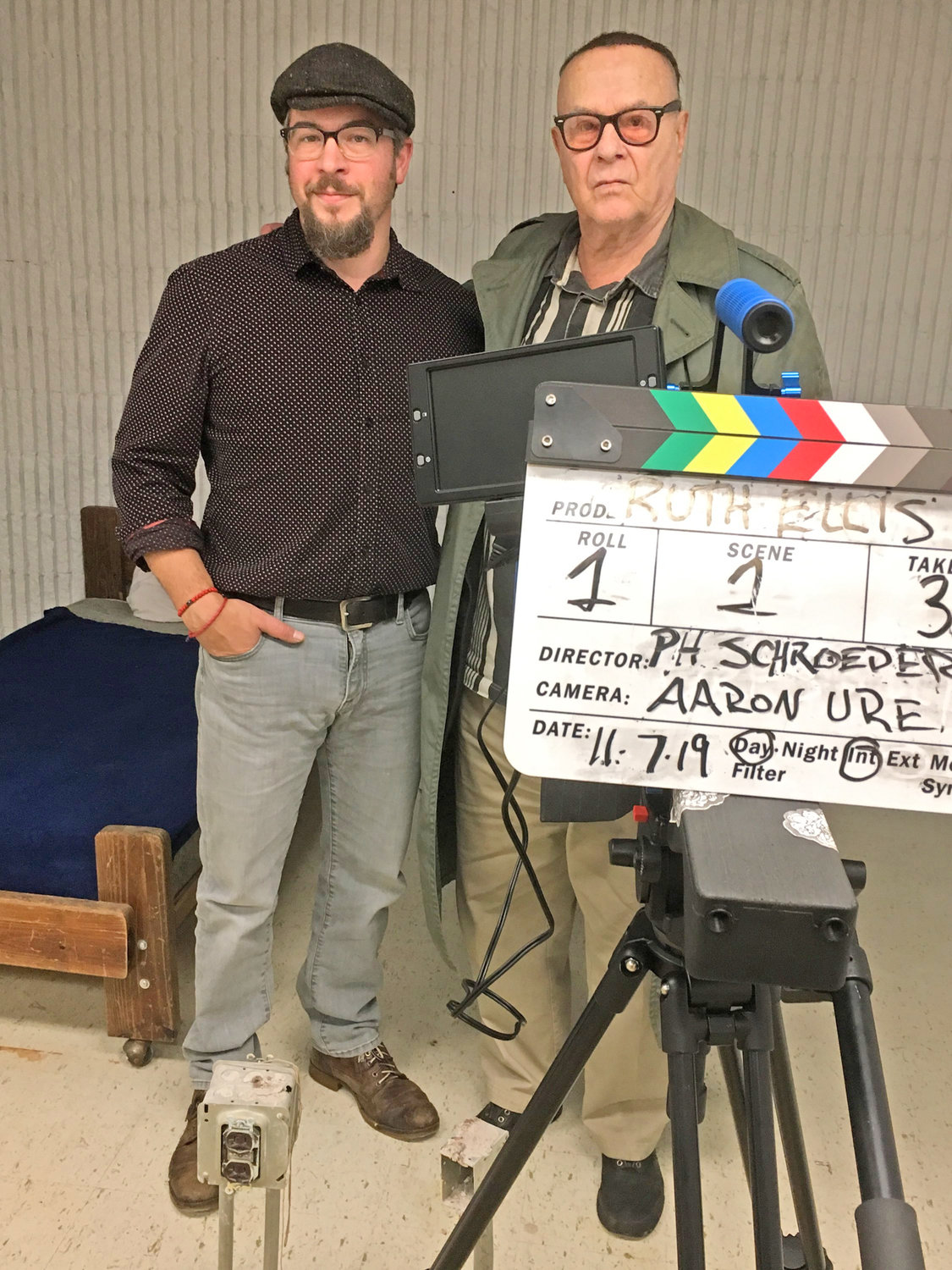 "COLLABORATORS — Aaron Ure, videographer, and producer/director Peter-Henry Schroeder pose for a photo inside a room at Oneida Municipal Center they are using to shoot the feature film, ""Ruth Ellis."""