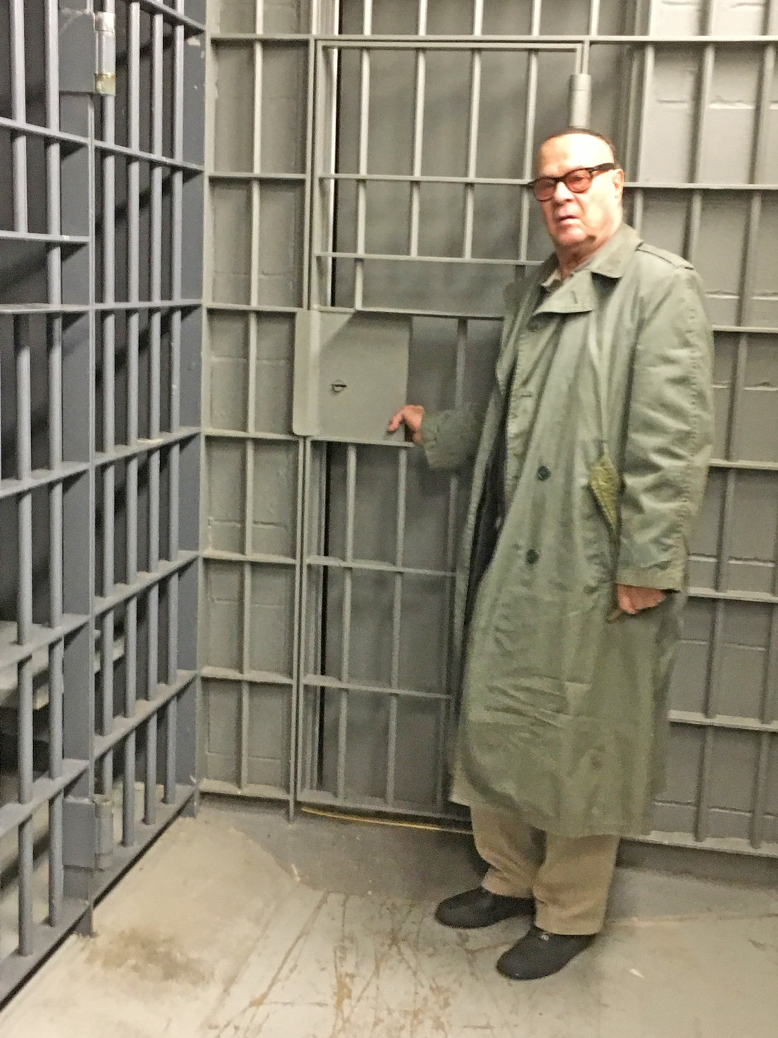 "BEHIND THE SCENES — Los Angeles actor/director/producer Peter-Henry Schroeder, native of Rome, stands inside one of the former Oneida City Jail cells, which will act as the setting for his film, ""Ruth Ellis,"" that is being shot locally."