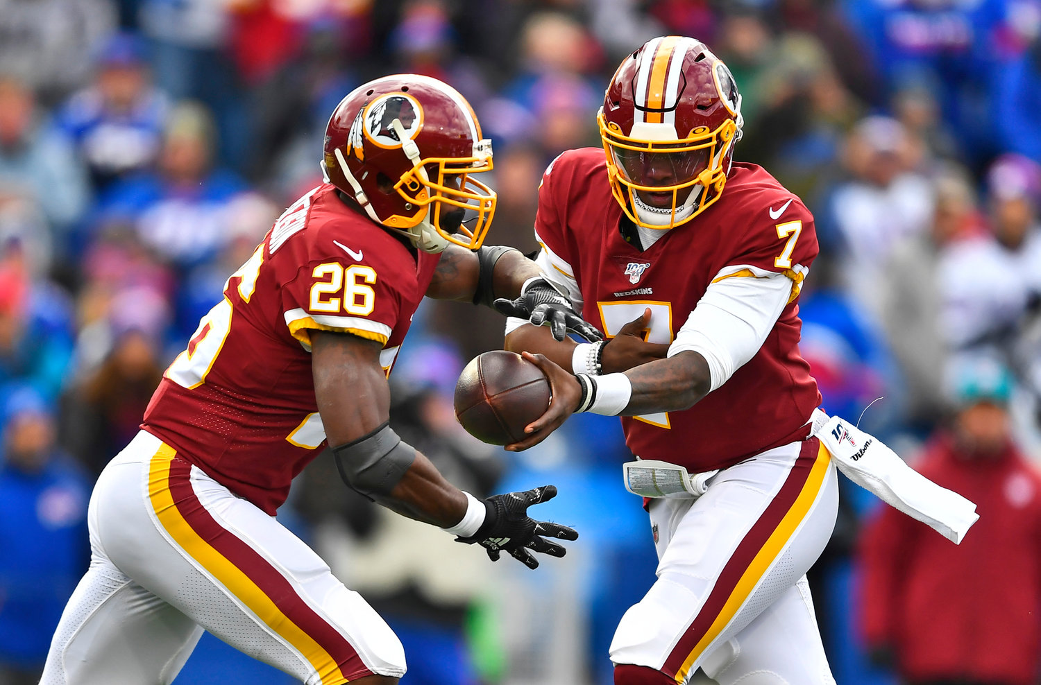 STARTING FOR THE REDSKINS — Quarterback Dwayne Haskins hands the ball to Redskins teammate Adrian Peterson during a game against the Bills on Nov. 3. Haskins, who has been named Washington's starting quarterback for the rest of the season, will face the Jets on Sunday.