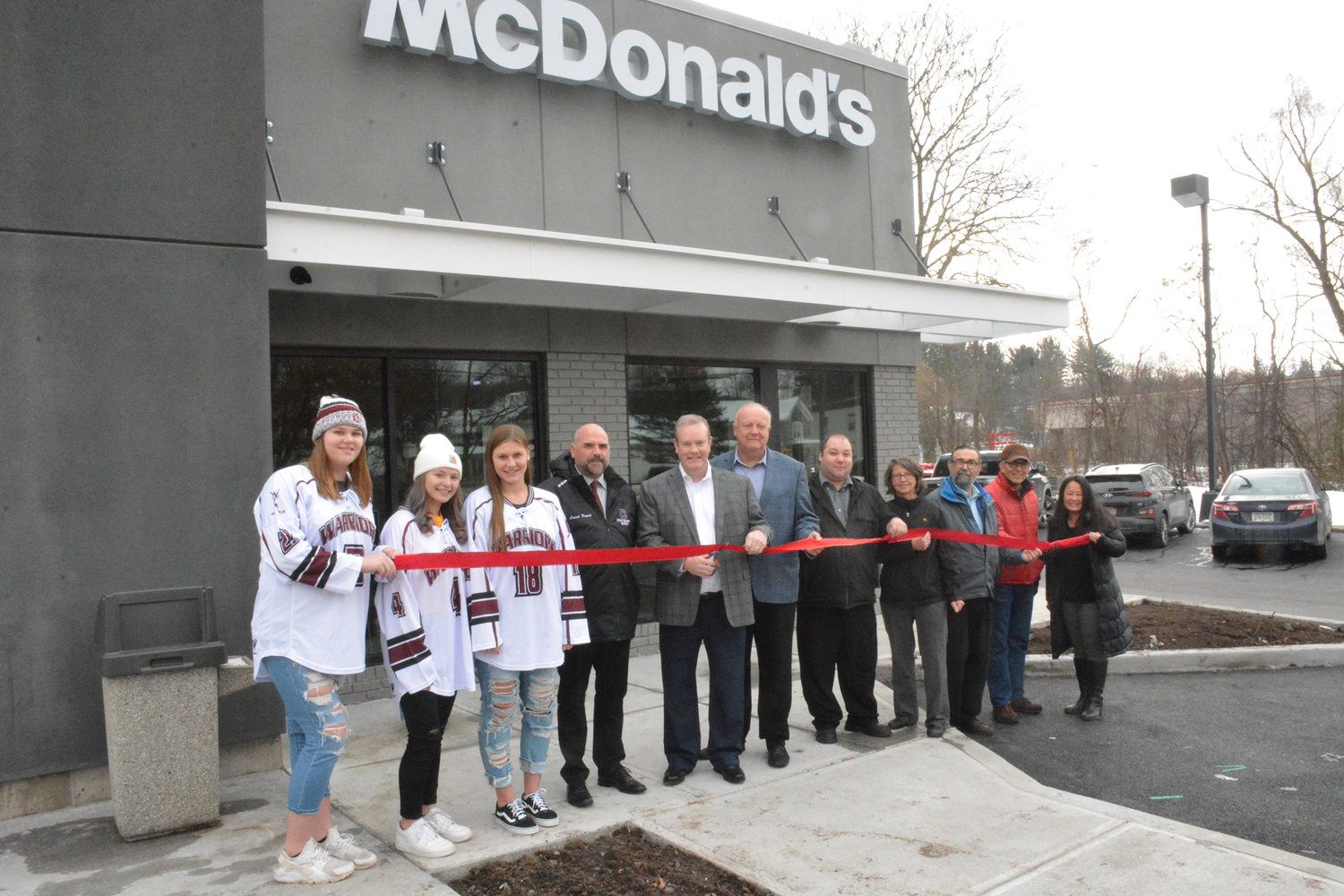 OPEN FOR BUSINESS — The Clinton Chamber of Commerce held a ribbon cutting ceremony for the Kirkland McDonald's on Meadow Street on Friday, Nov. 15. The major renovation project lasted eight weeks and boasts new features like a McCafe coffee bar and self-serving order kiosks. Pictured from left are Clinton girls hockey members Madison Dery, Abby Burns, Mia Lopata, Clinton girls hockey assistant coach Rob Kopek, Location Owner Tom Clark III, Director of Operations Mac Clark, Al Dohn, General Manager Rendall Perkett, Supervisor Donna Armstrong, Kirkland Deputy Town Supervisor Garry Colarusso, Village of Clinton Mayor Steven J. Bellona and Clinton Chamber of Commerce Executive Director Jackie Walters.