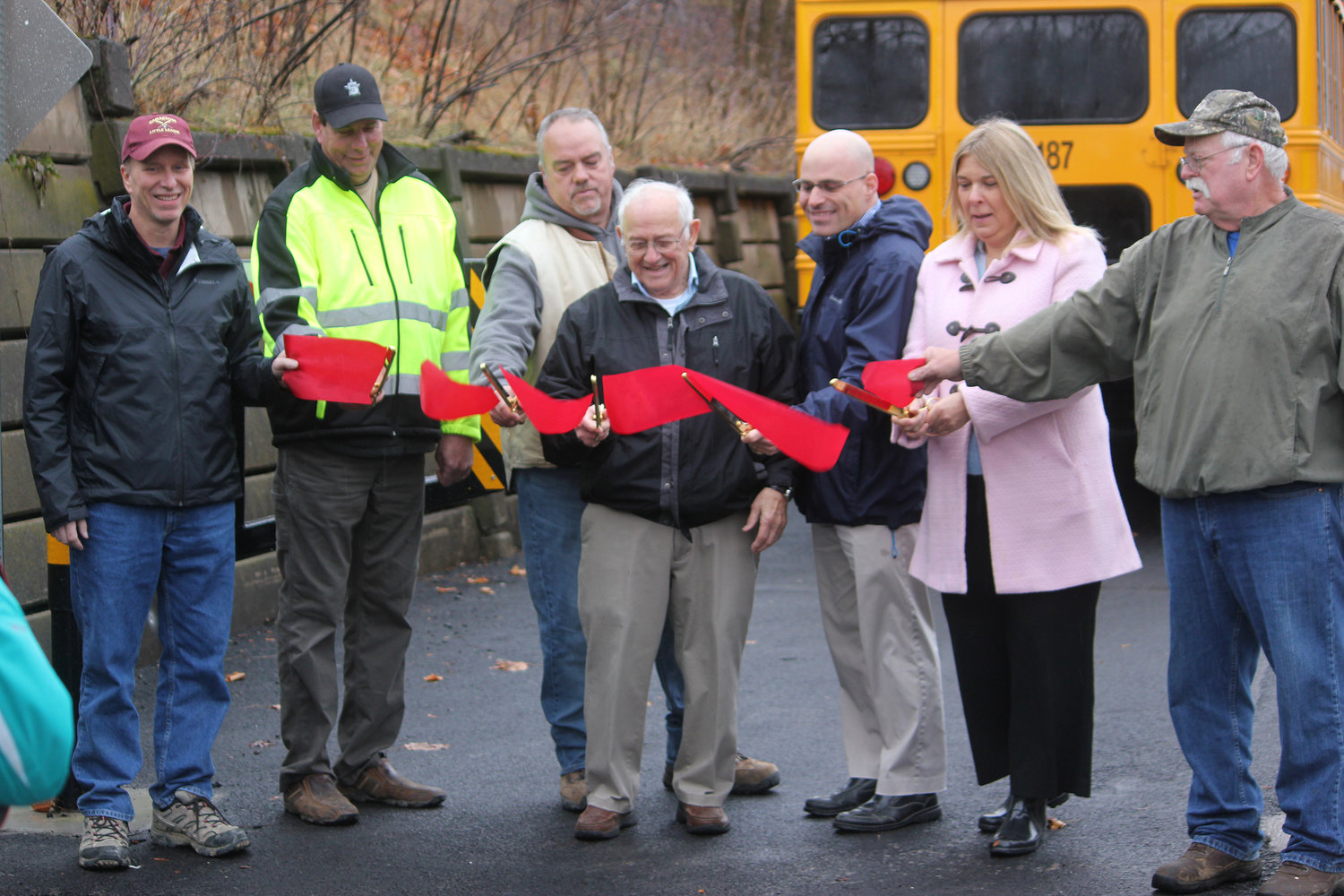 OFFICIALLY OPEN — Local and county officials cut the ribbon, officially opening the Lenox Rail Trail on Thursday, Nov. 22. Officials hailed the trail's official opening, after years of hard work.