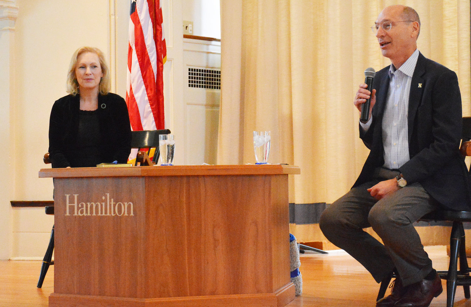PROPER INTRODUCTION — Hamilton College President David Wippman, right, introduces U.S. Sen. Kirsten Gillibrand, D-NY, during a special town hall meeting held in the college chapel on Monday, Nov. 18.