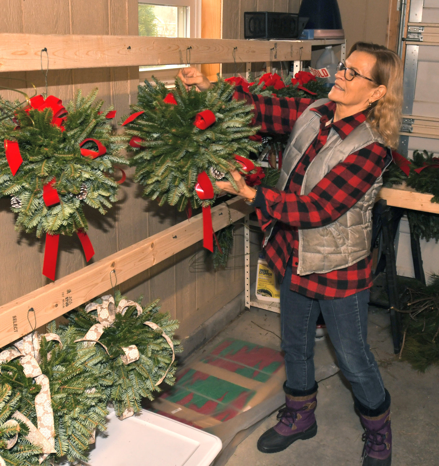 DECOR — Julie Shuster hangs a Kissing Ball at her Verona tree farm on Black Friday as they opened up their tree farm for the Christmas season.