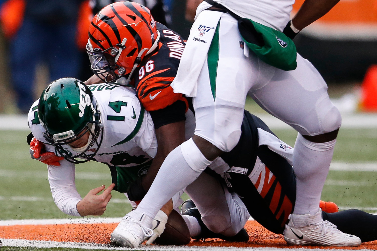 SACKED — Jets quarterback Sam Darnold is sacked by Bengals defensive end Carlos Dunlap during the second half of an NFL game on Sunday in Cincinnati. The Jets lost 22-6.