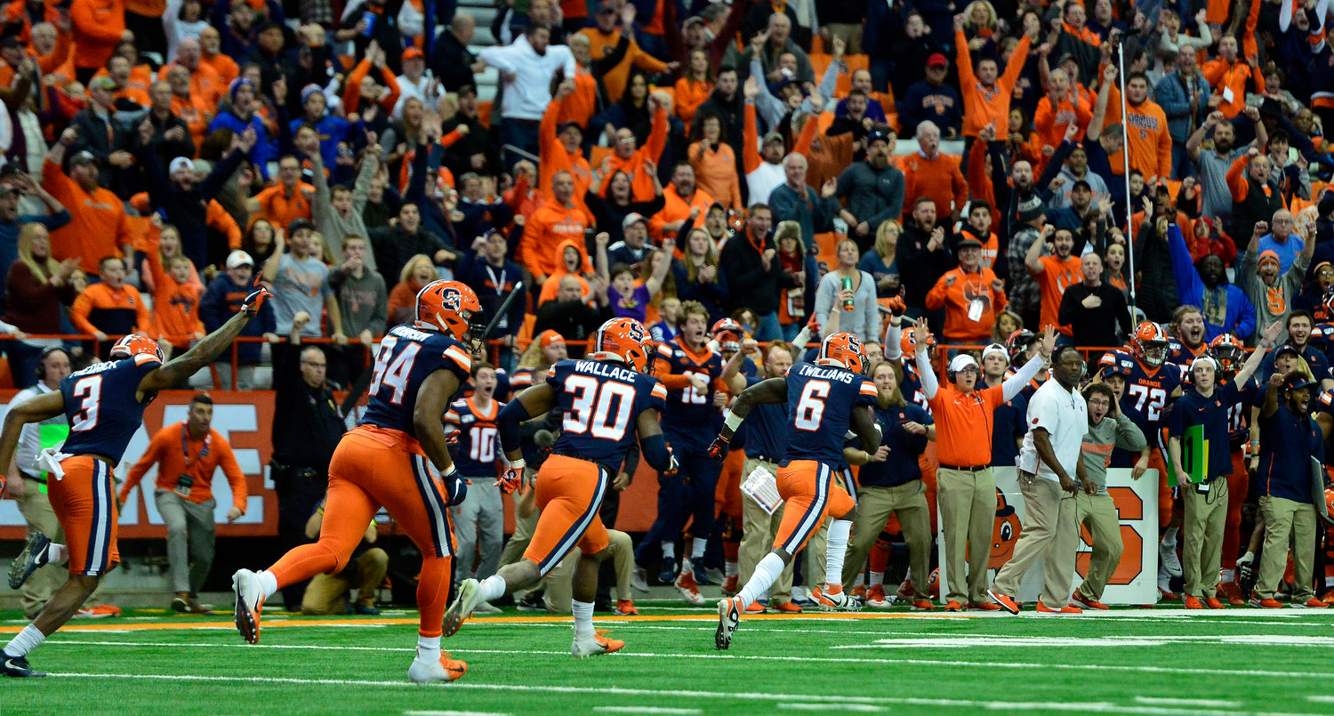 SEALING THE WIN — Syracuse defensive back Trill Williams (6) returns a fumble for a touchdown to seal the win against Wake Forest during overtime in a college football game in Syracuse on Saturday. Syracuse beat Wake Forest 39-30 in overtime.
