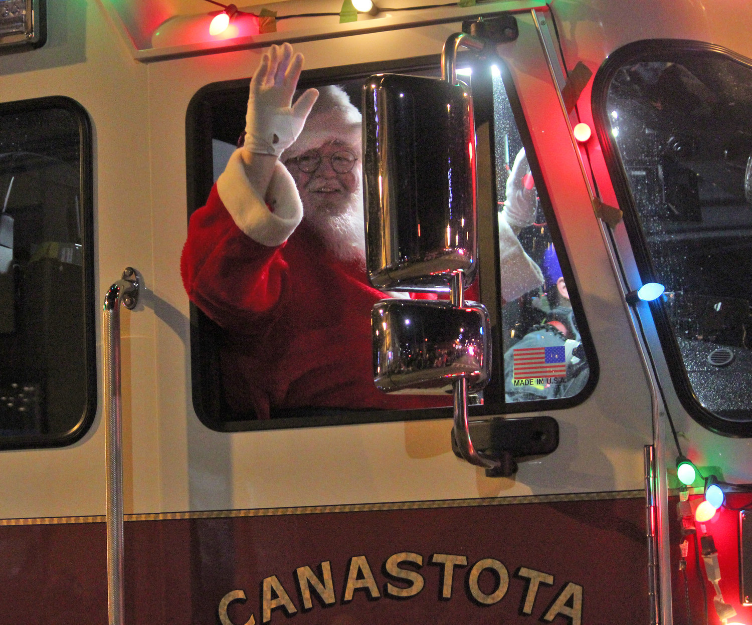 COMING TO TOWN — Santa Claus gets a ride from the Canastota Fire Department down South Peterboro Street for the second annual Canastota Parade of Lights on Saturday, Nov. 30.