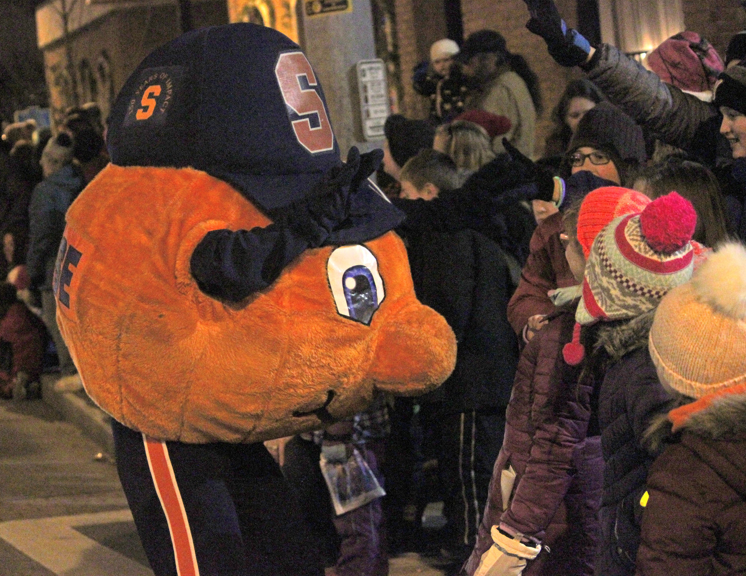SYRACUSE ORANGE — Otto the Orange joins in to welcome the season of giving for the second annual Canastota Parade of Lights on Saturday, Nov. 30.