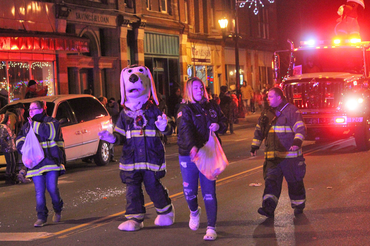 SEASON OF GIVING — The Canastota Fire Department hands out candy for the kids at the second annual Canastota Parade of Lights on Saturday, Nov. 30.