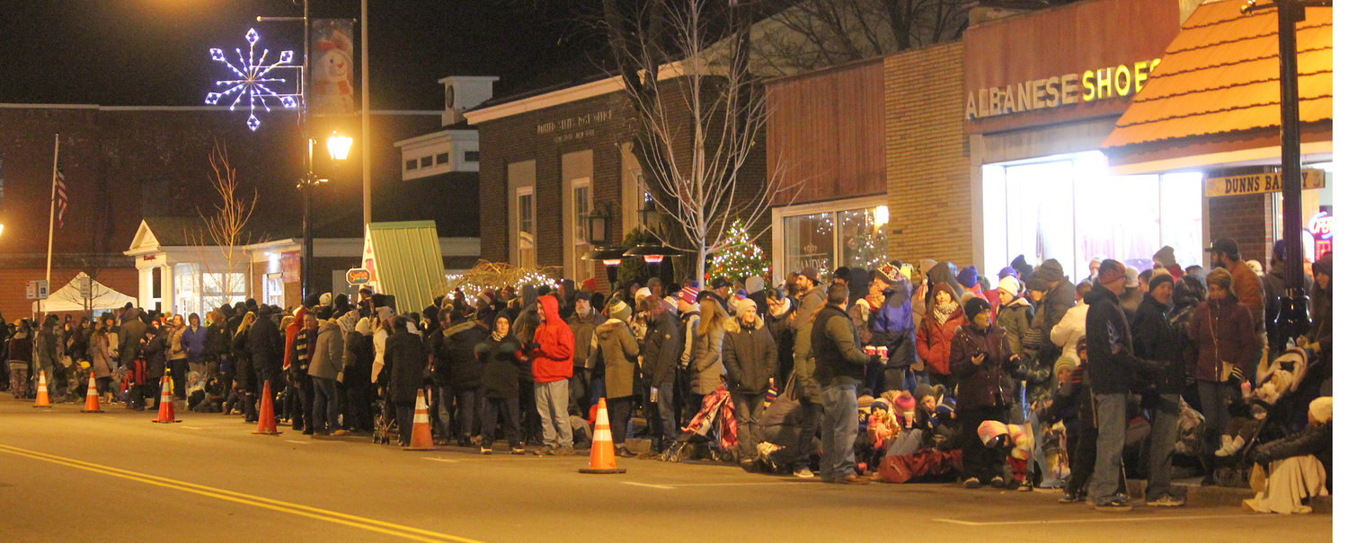 CHRISTMAS SPIRIT — Residents from all over come together to welcome the holiday spirit at the second annual Canastota Parade of Lights on Saturday, Nov. 30.
